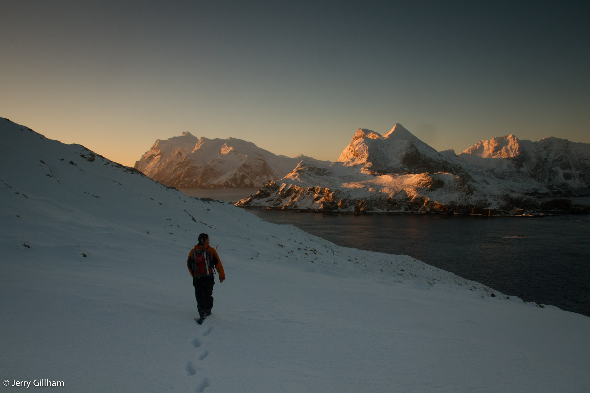 Early morning light catching the South Georgia mainland as we make footprints in the fresh snow.