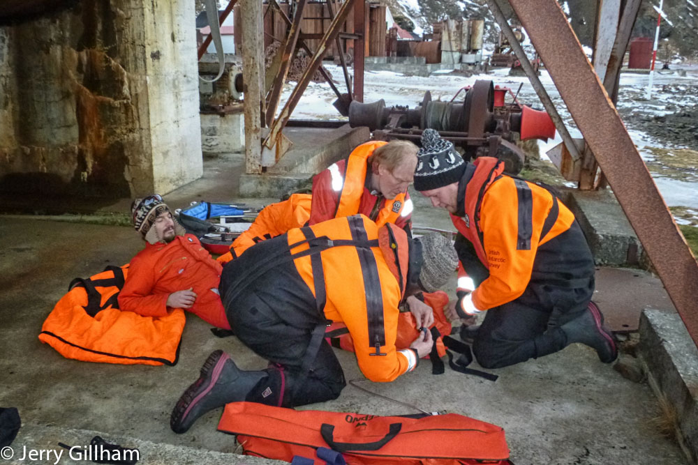 Fraser had 'broken his leg while playing on the old whaling station'. I was sent out as the quick response, taking the bike and pedalling round to meet him with a big orange blanket and some warm clothing. Shortly afterwards the main team arrived and splinted his leg up.