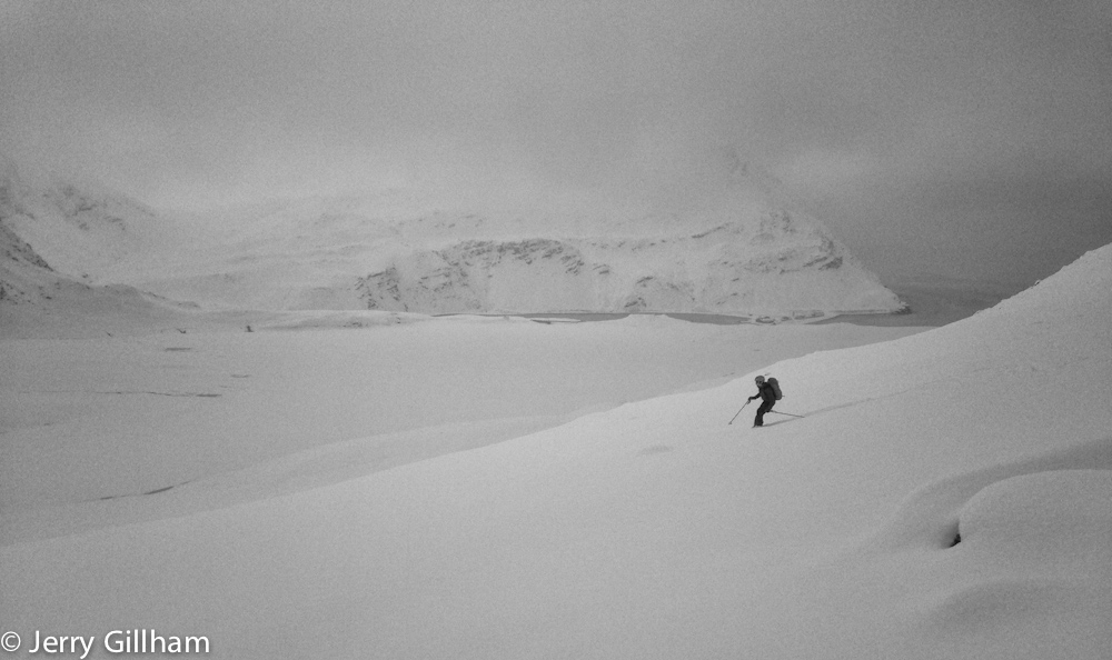 Fraser on the slopes of Brown Mountain. The flat area below is the snow-covered Gull Lake. Visibility was often poor but where the snow was deep enough it was so easy to turn it didn't matter what the slope was like.