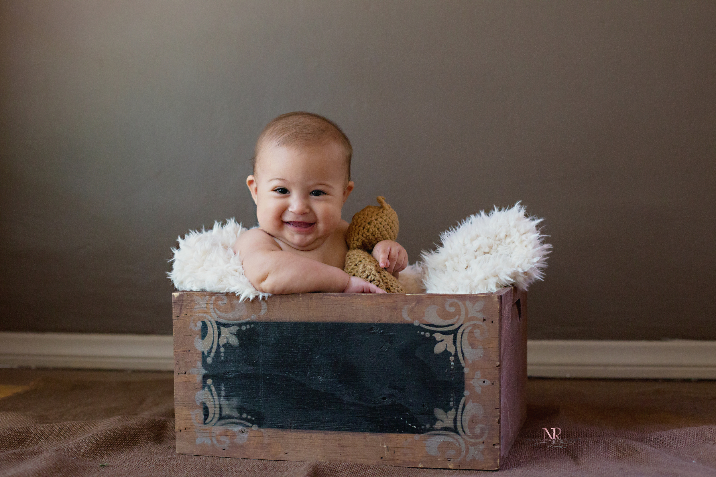 He looks so darling in the box! Baby and boxes- I just love it! Here are some more of that smile!