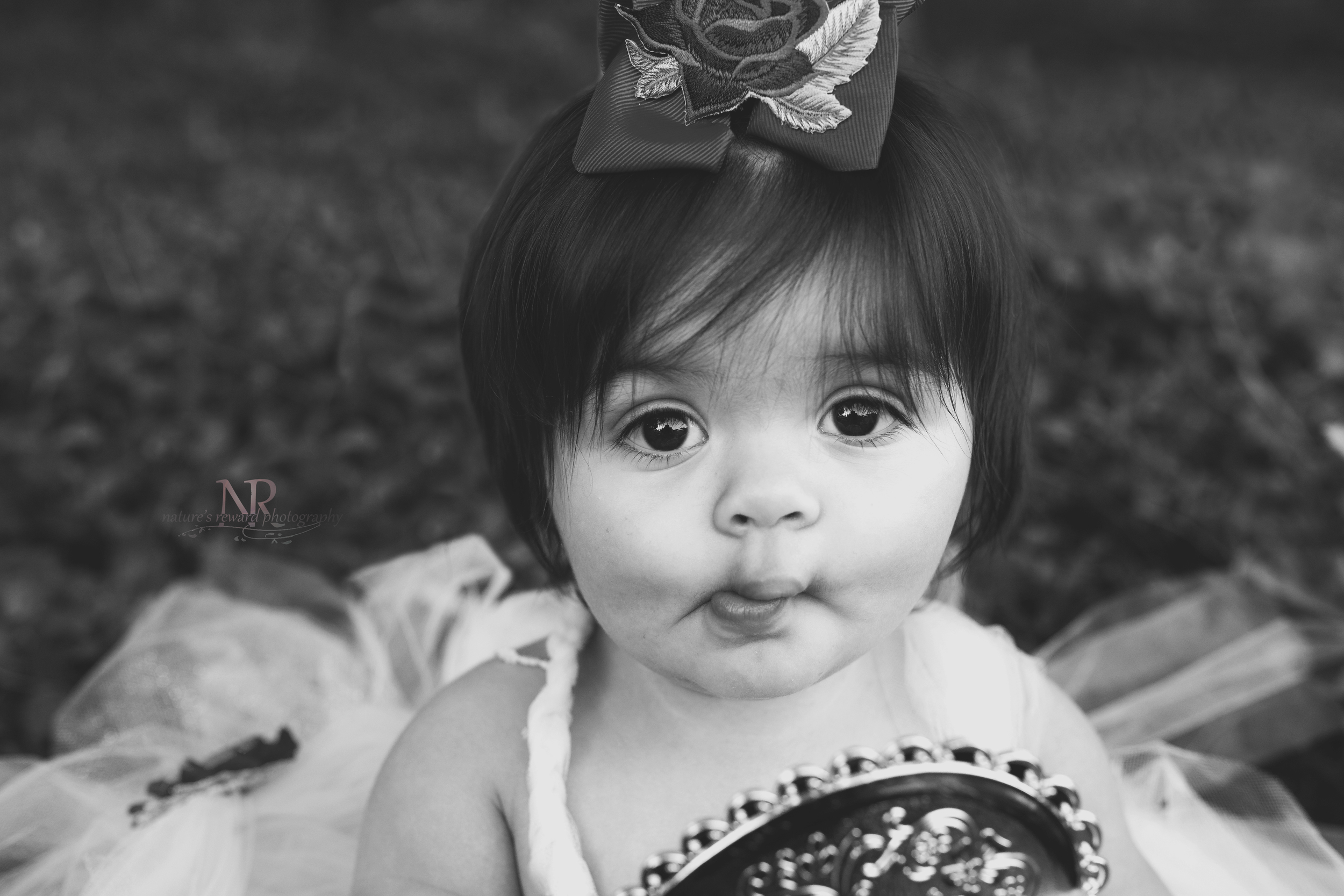 I have never enjoyed duck lips in a picture until this baby girl! She does this when she is being shy! OMG I could hardly contain mysel f- she is so stinking cute! Those Big eyes!