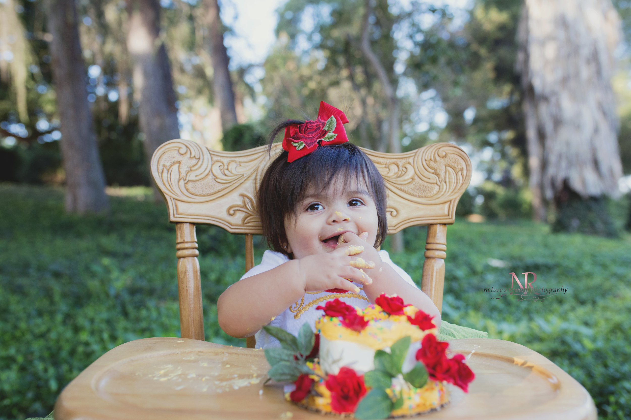 A big smile  for a gorgeous cake. She dug in during the cake smash part of this session