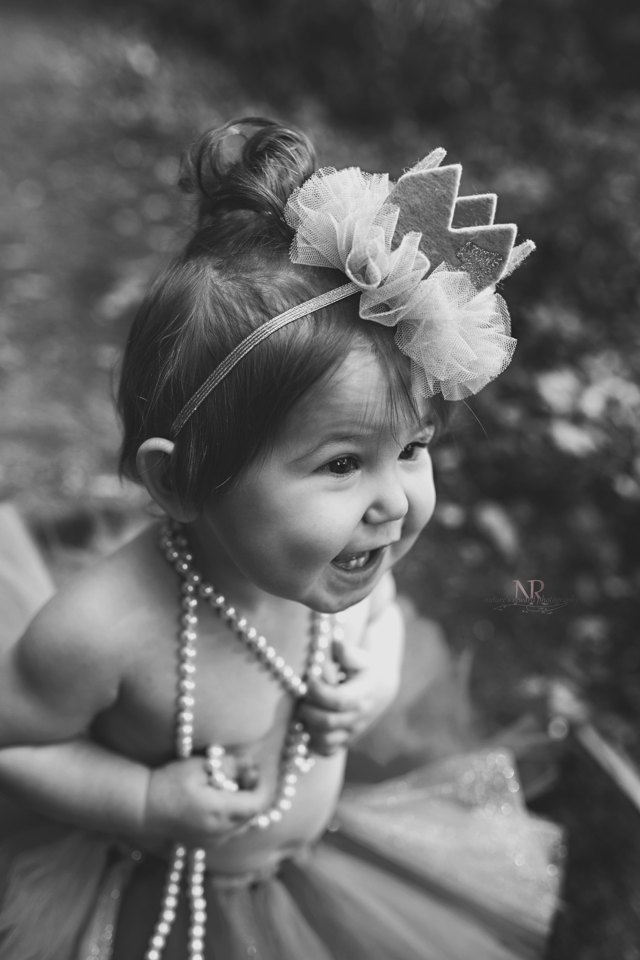 Her belly laugh in pearls