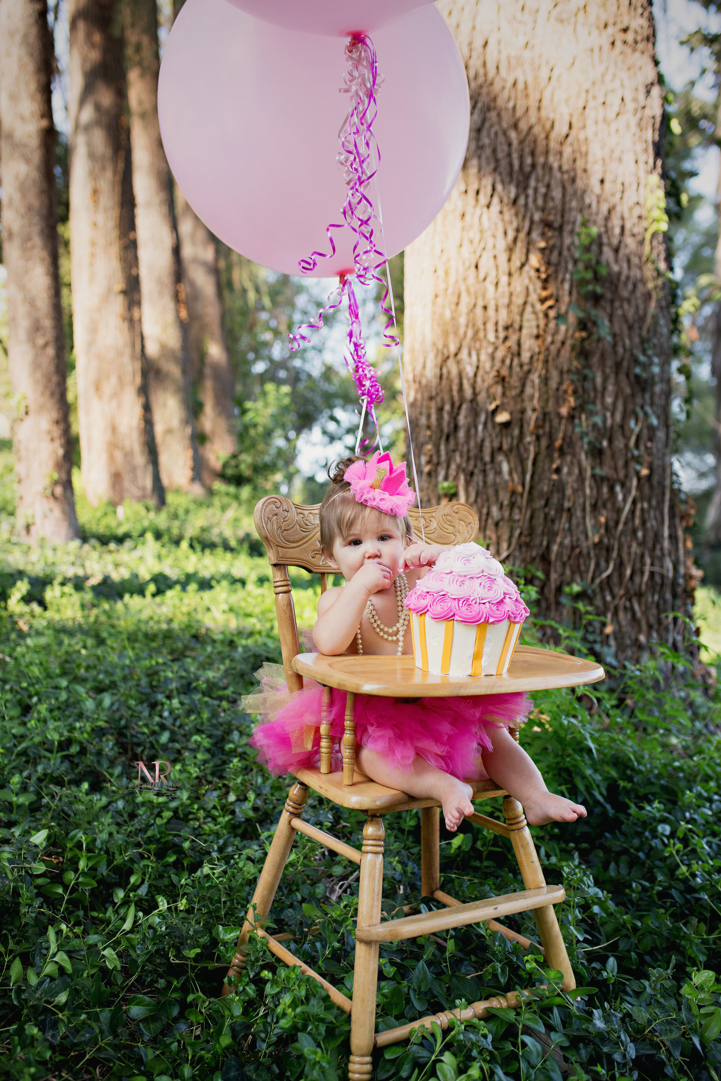 This gorgeous cupcake cake was as pretty as it was ginormous! She was immediately interested and is already licking icing o ff finger in this first image of her cake smash session in Redlands