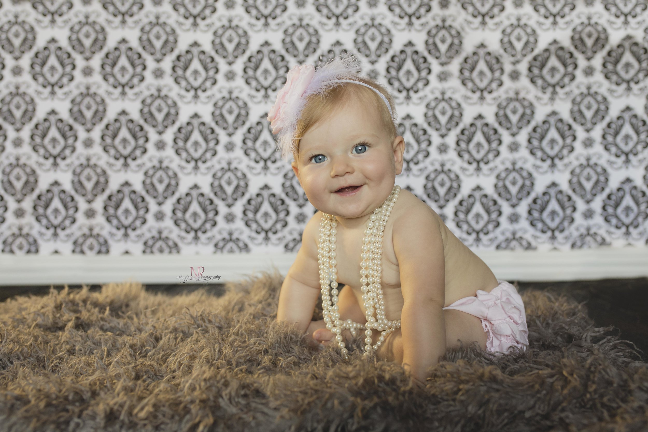 Look at those big bright eyes! Not to mention that smile! Mom requested damask backdrop to match what she has o f her other children.