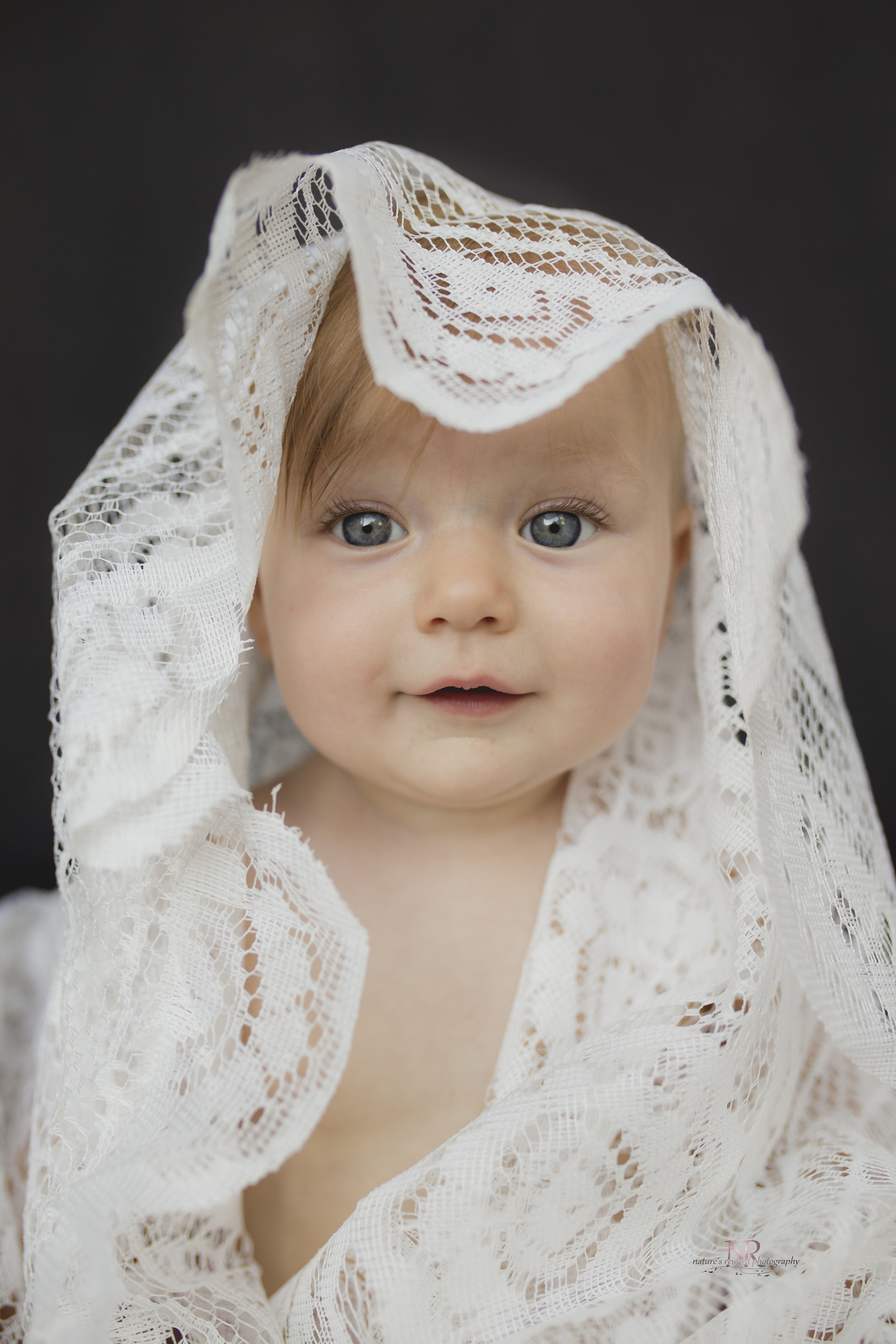 One o f my favorites from the session. Love the smirk and the big eyes! This is a forever on the wall kind of picture!