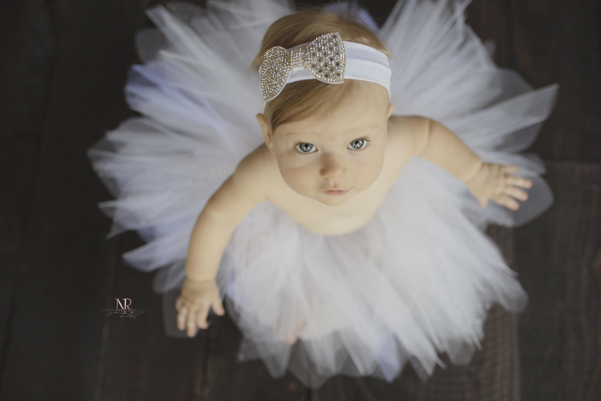Small change here- but i love the looking up like this. Her Eyes pop and she looks like a baby doll ballerina!