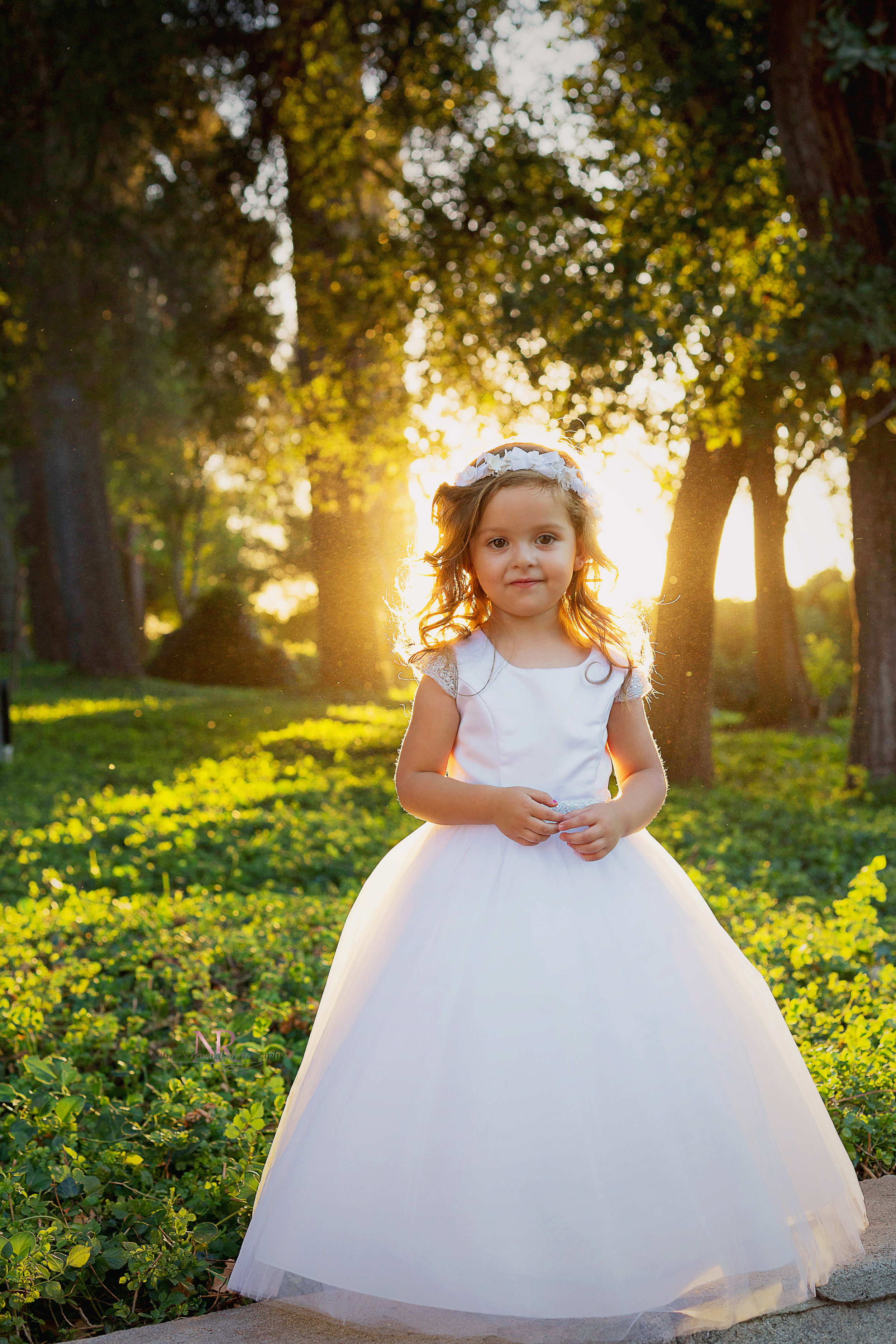 On her baptism dress.  With the sun!  And the Smile!  And omg the dust all lit up like that!  I have no other words!  This is just stunning to me!