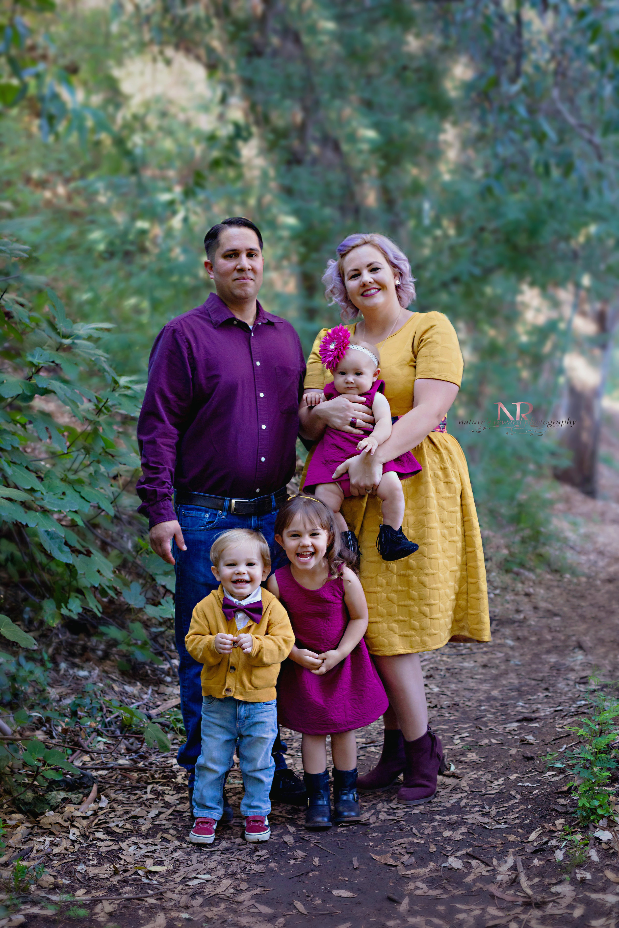 Family portrait. Those darling real smiles. No saying cheese! Look at these gorgeous colors!