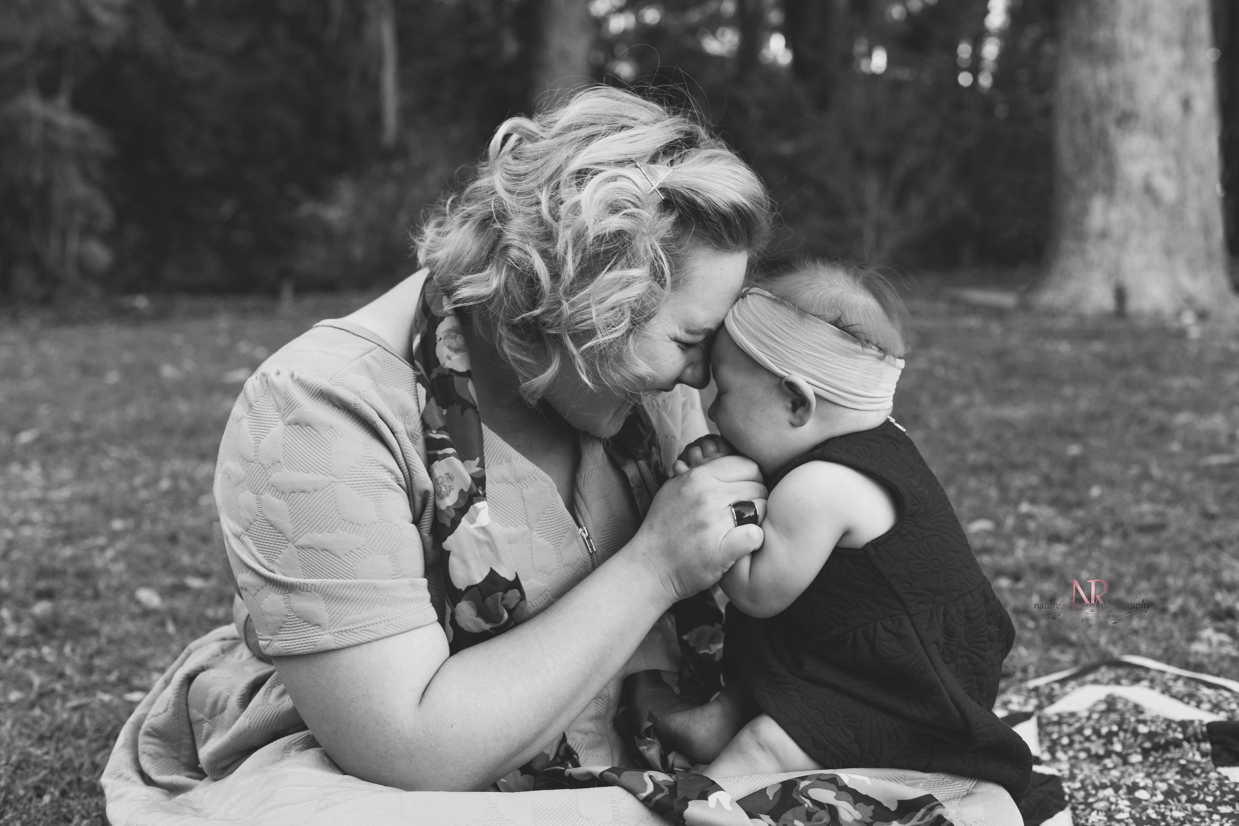 A per fect Moment. What I would give to have this captured of me with my babe. This is one lucky momma. She looks so lovely and so very happy.