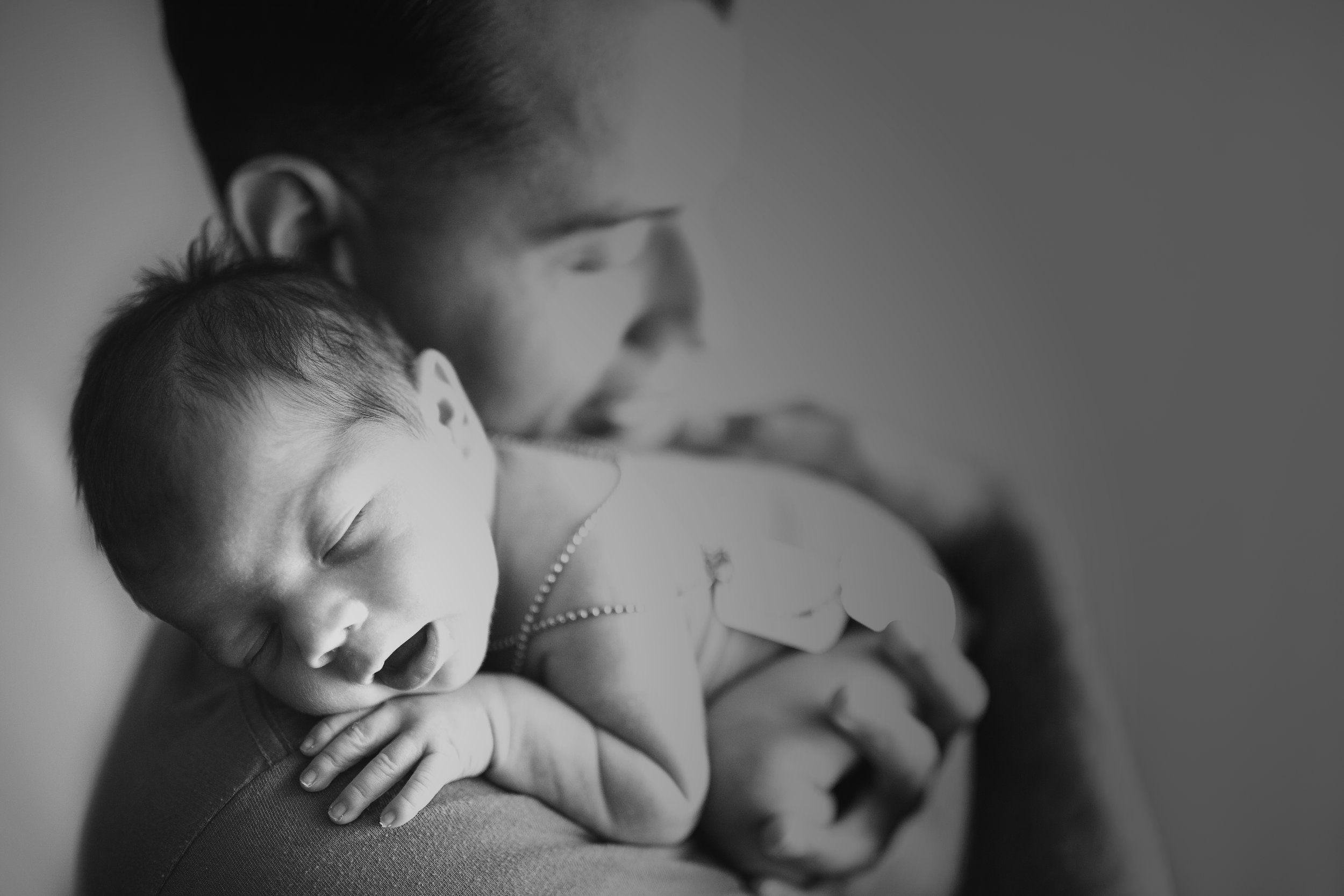 And he lifted him onto his shoulder, the baby naturally moved into this sweet position taking posed photography into the documentary.