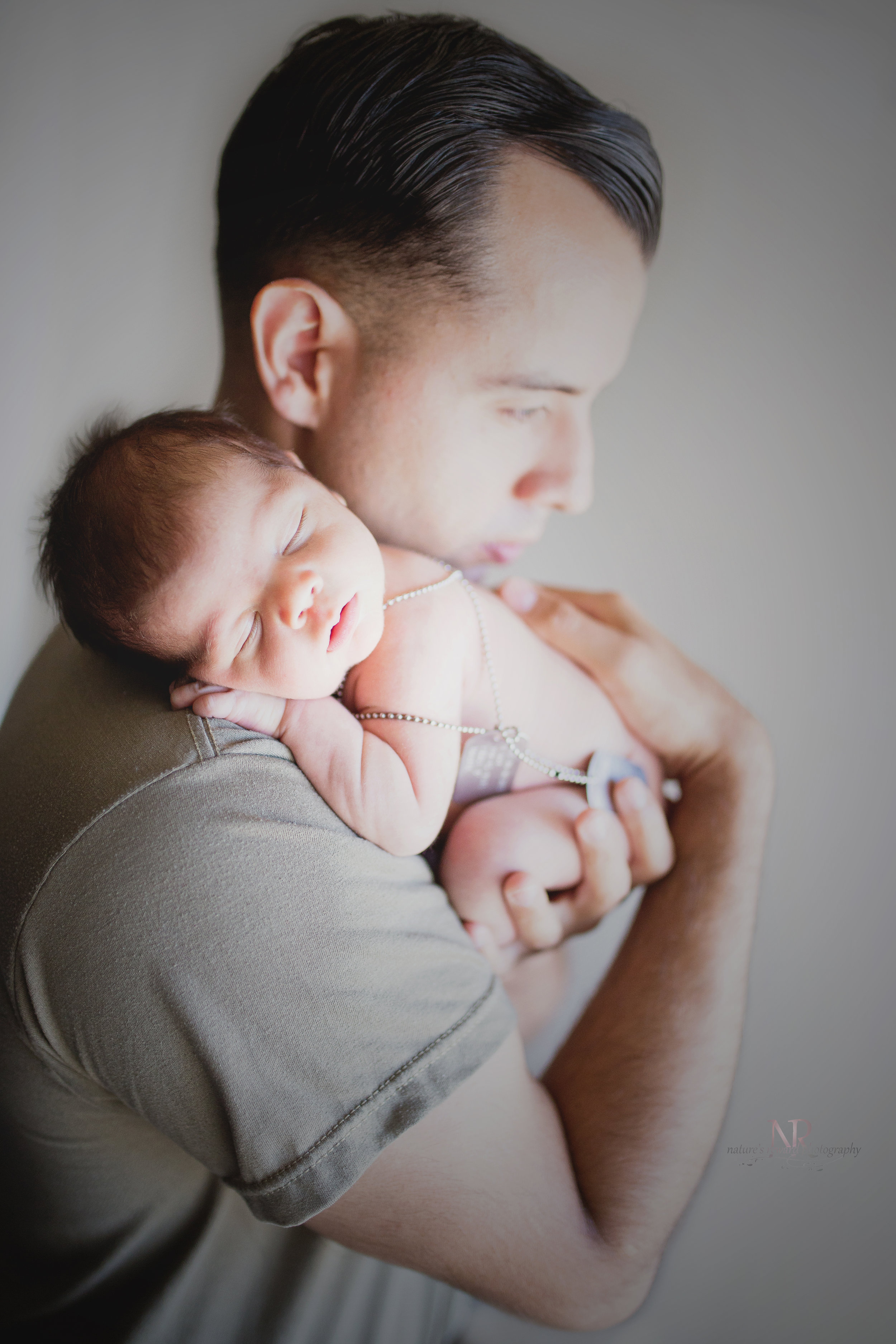 My favorite with dad. This newborn portrait speaks for itself.