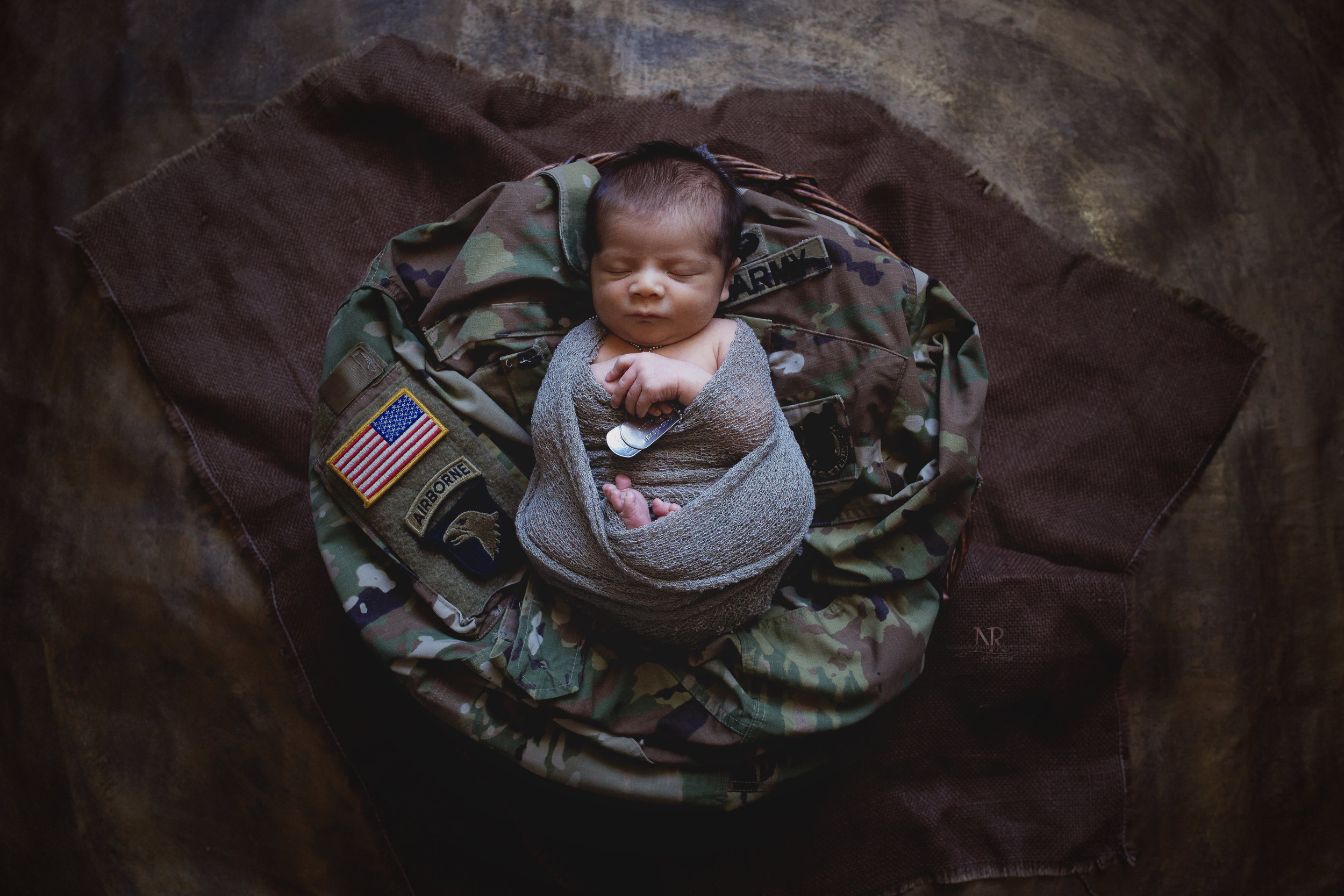 Newborn Baby Boy Lays on his dad's service uniform. {Name cloned out for privacy} I knew ahead of time that they wanted their baby boy to lay on this jacket. I wanted to look more impressive than a pile of laundry and give the uniform the respect it deserves. I hope I did it justice.