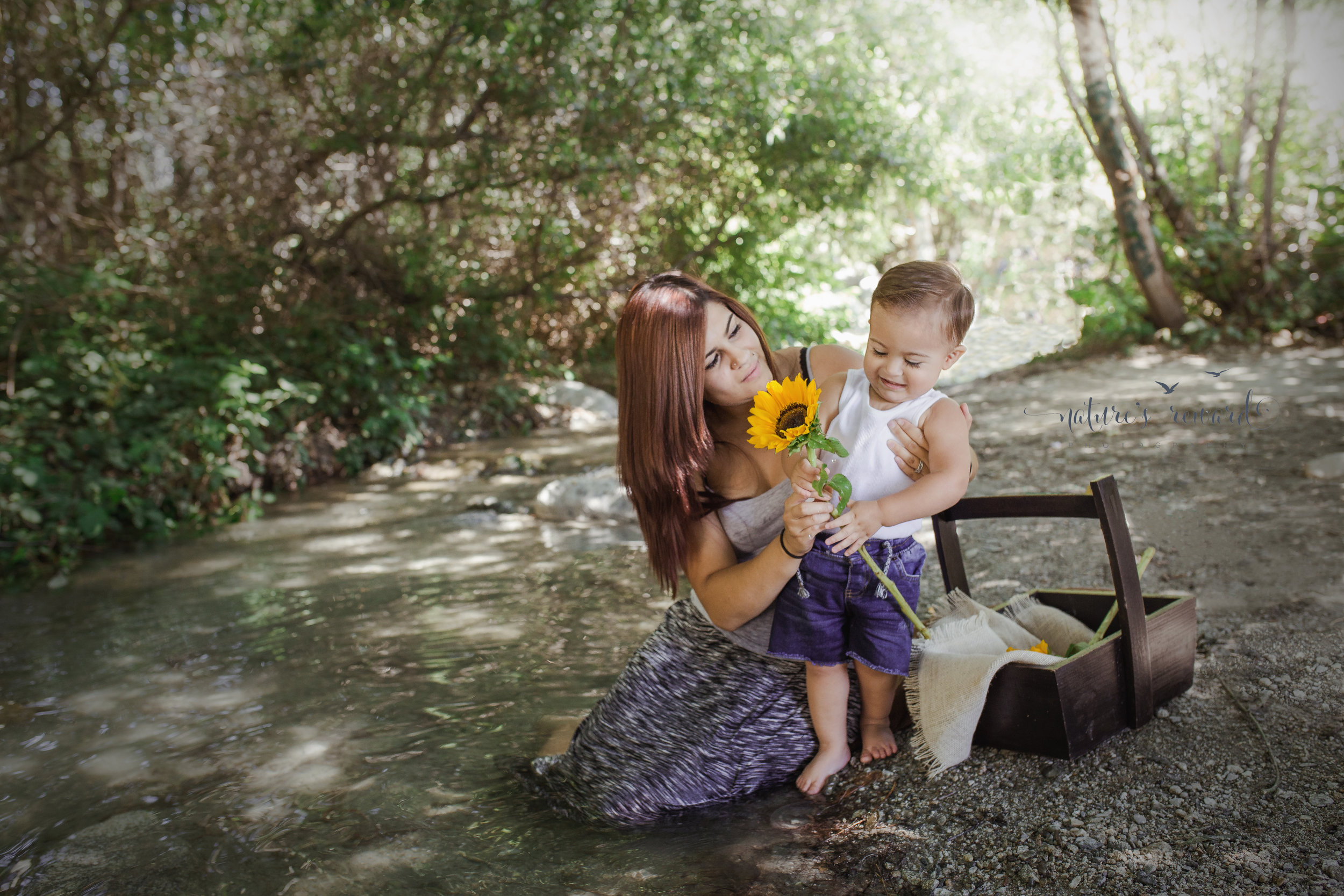 A flower like no other.  Her son blossoms in her doting care and love in this creekside portrait. Image by Nature's Reward Photography, a Southern California newborn, family and child photographer