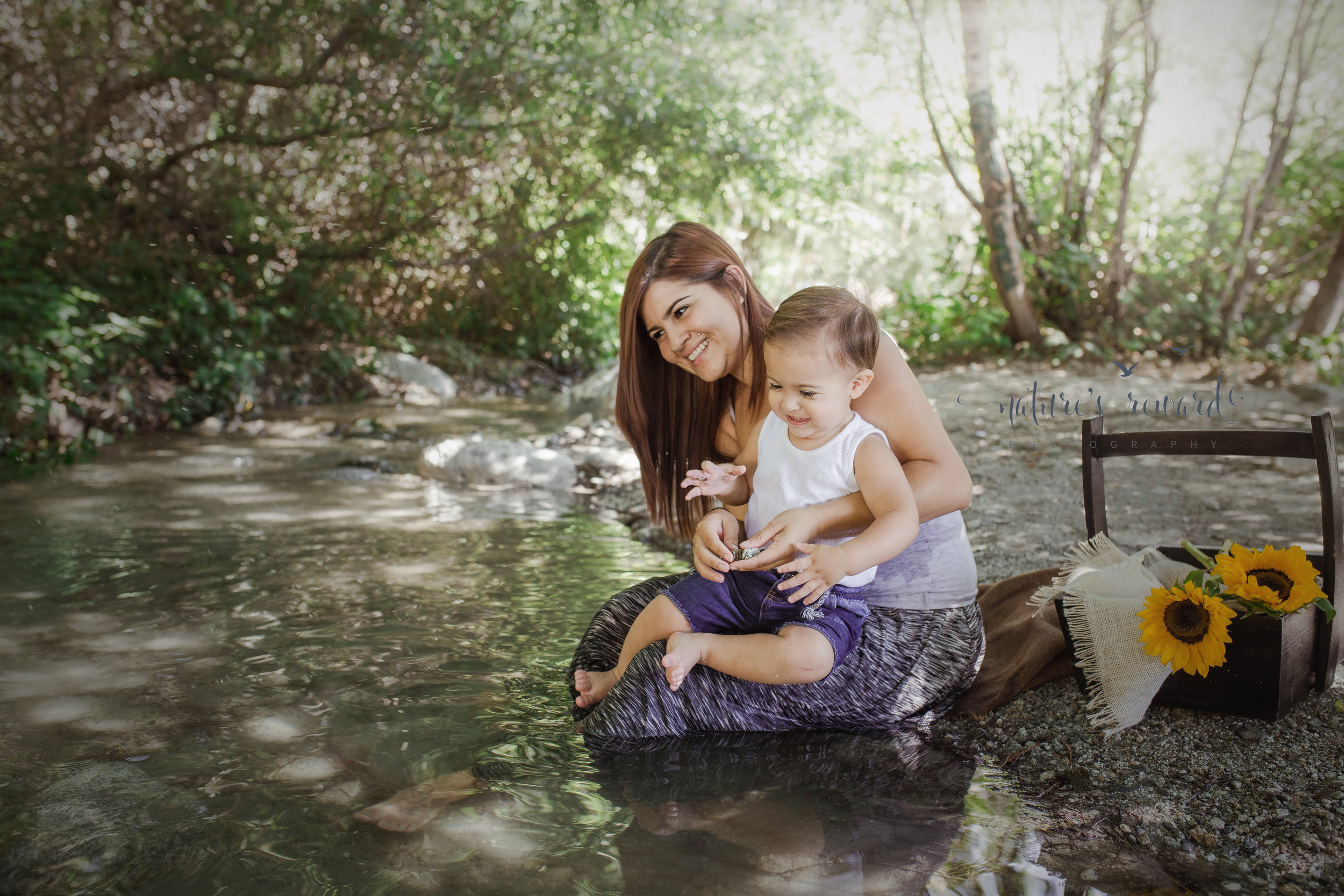 Little boys and throwing rocks.  Here we laugh at the innate need little boys have to throw rocks and see big splashes.  Oh the joys of boy mom hood. Image by Nature's Reward Photography, a Southern California newborn, family and child photographer