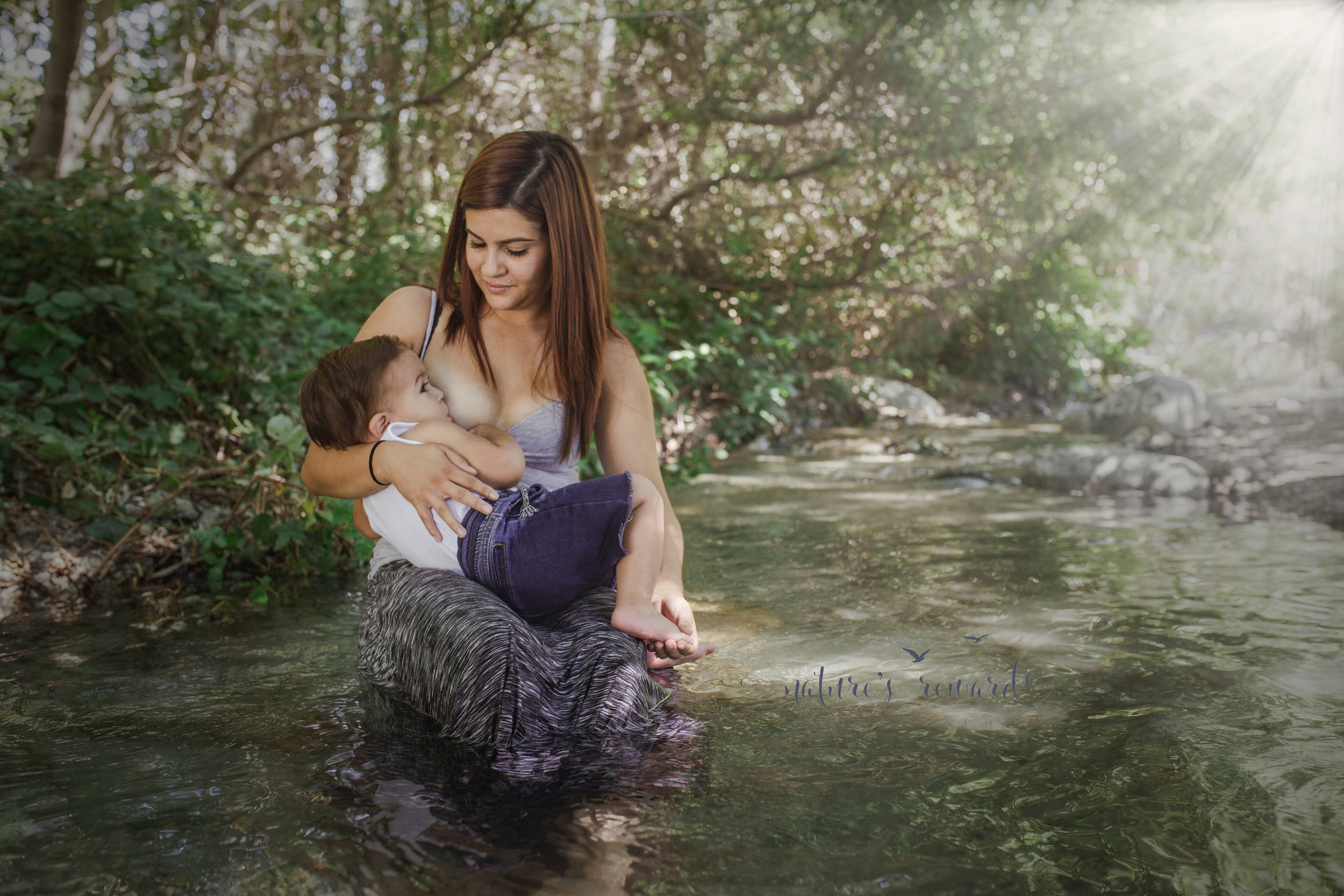 Madonna. Breastfeeding mother in a creek.  The love.... Image by Nature's Reward Photography, a Southern California newborn, family and child photographer