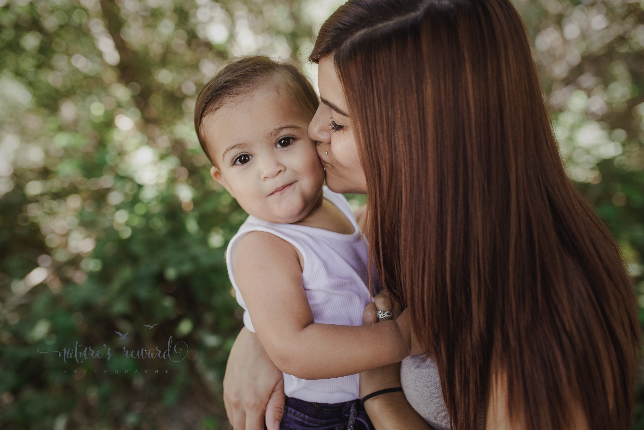 And that grin as mom kisses him.  I love this image!  Image by Nature's Reward Photography, a Southern California newborn, family and child photographer