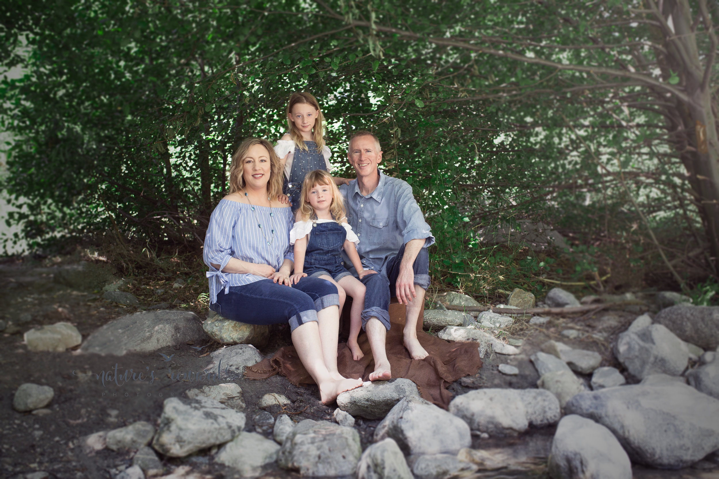 Lovely Family sits among the beauty of nature, smiling! Portrait by Nature's Reward Photography- a southern California photographer