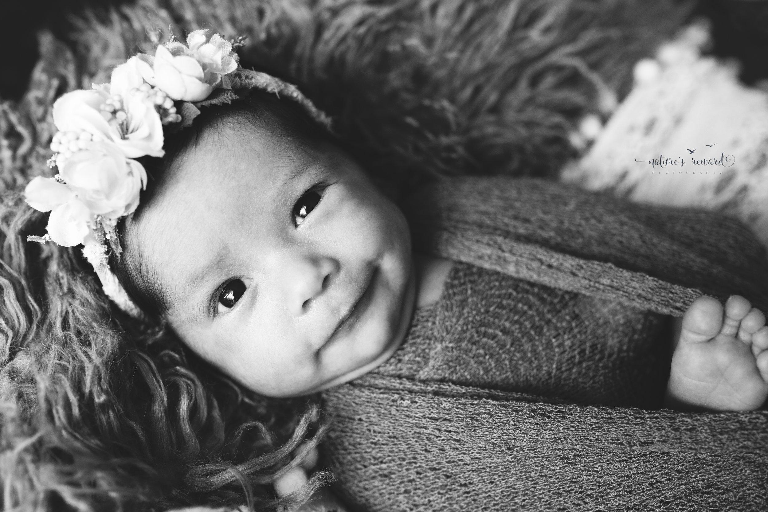 The grin. Newborn baby girl in a black and white image!