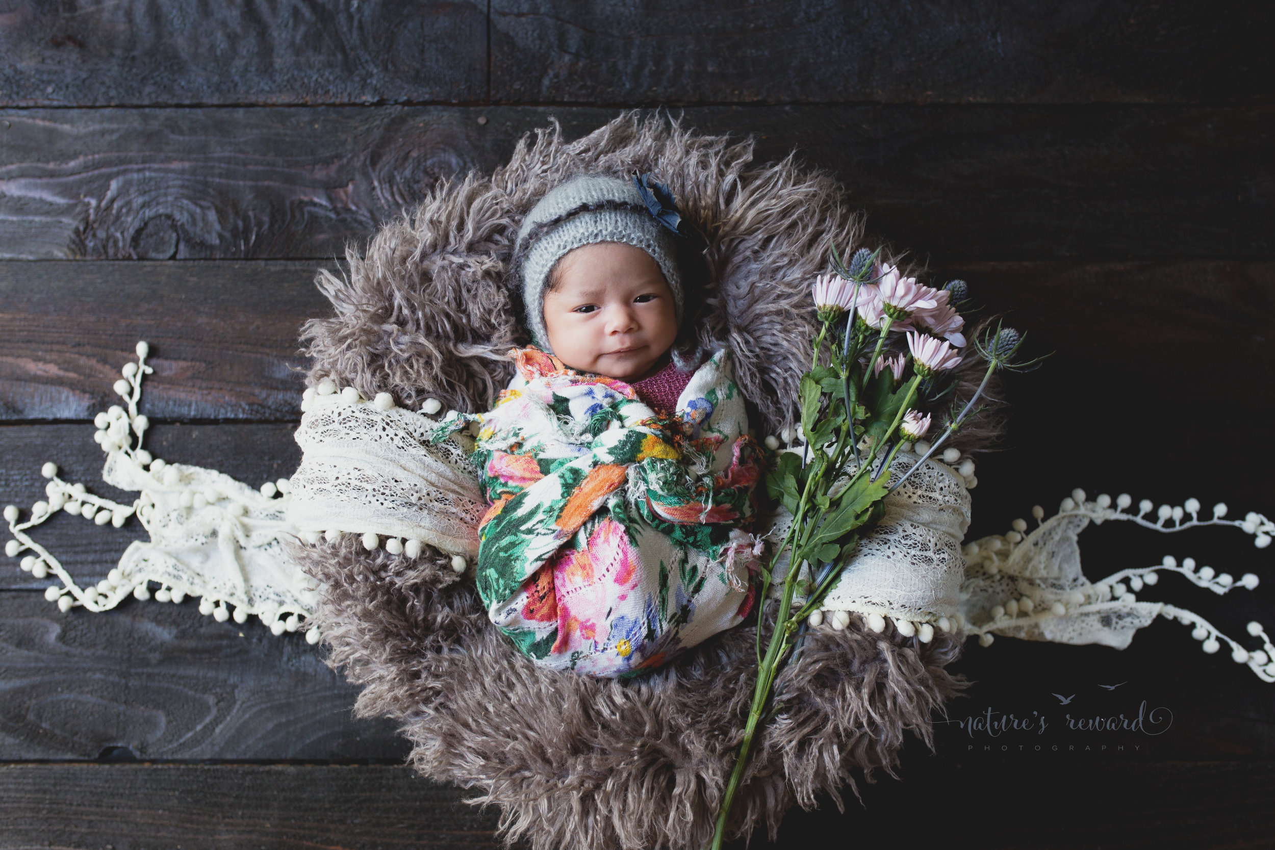 Baby in floral print. She is beautiful. My most requested set up.