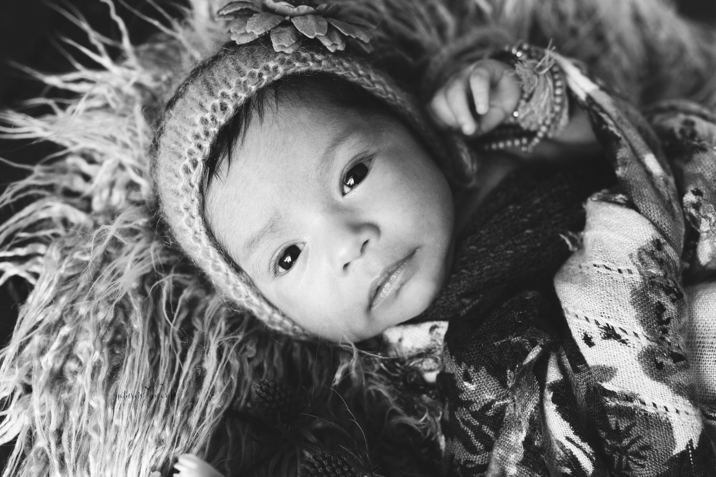 And a sweet Newborn girl. Awake. Her eyes startling in this black and white image.