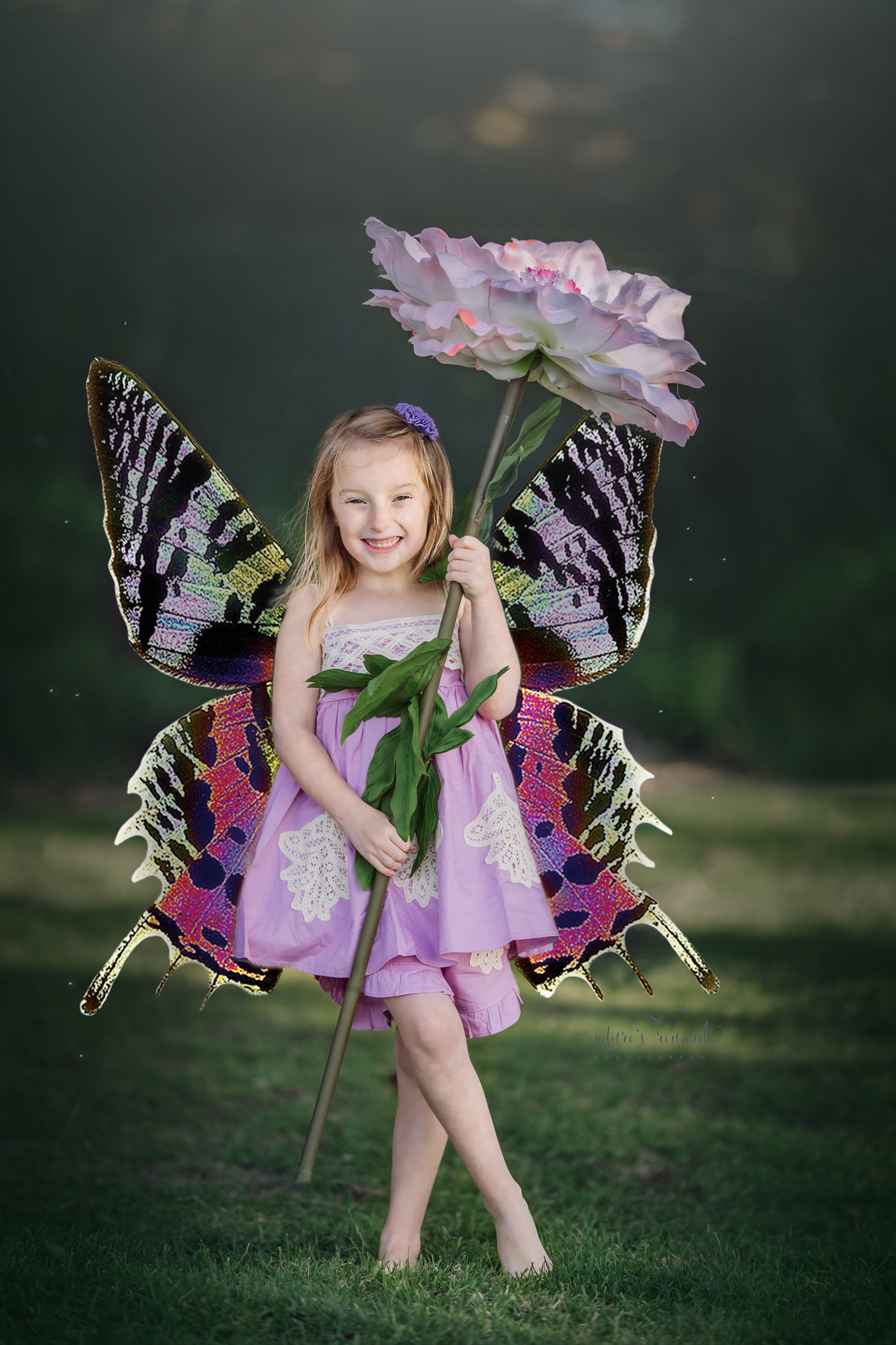 The butterfly pixie holding her flower umbrella in a purple dress and bloomers in this composite portrait by Nature's Reward Photography, a Southern California Photographer