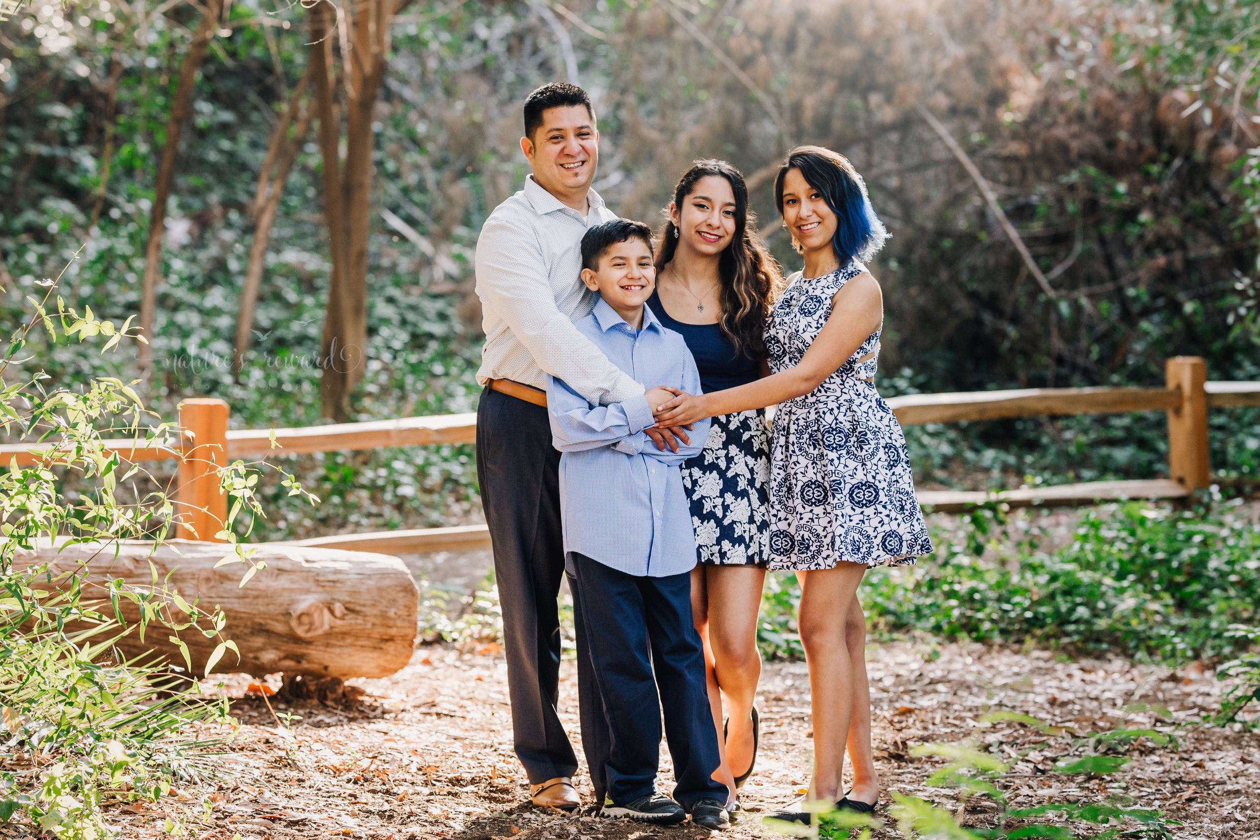 Just dad and us wearing blues and blue florals dresses in this gorgeous family photography portrait by Nature's Reward Photography.