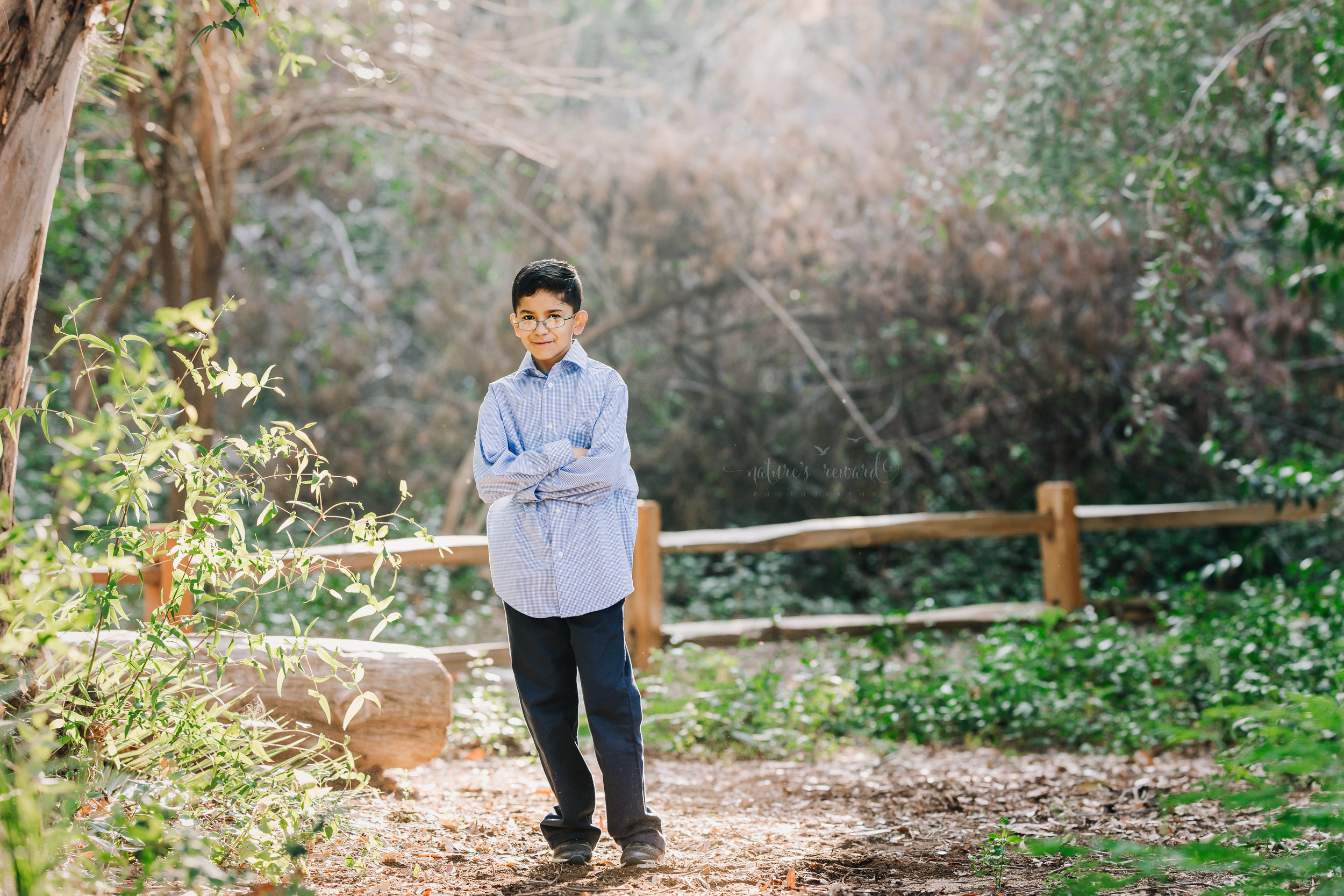 Handsome young boy wearing blues photography portrait by Nature's Reward Photography.