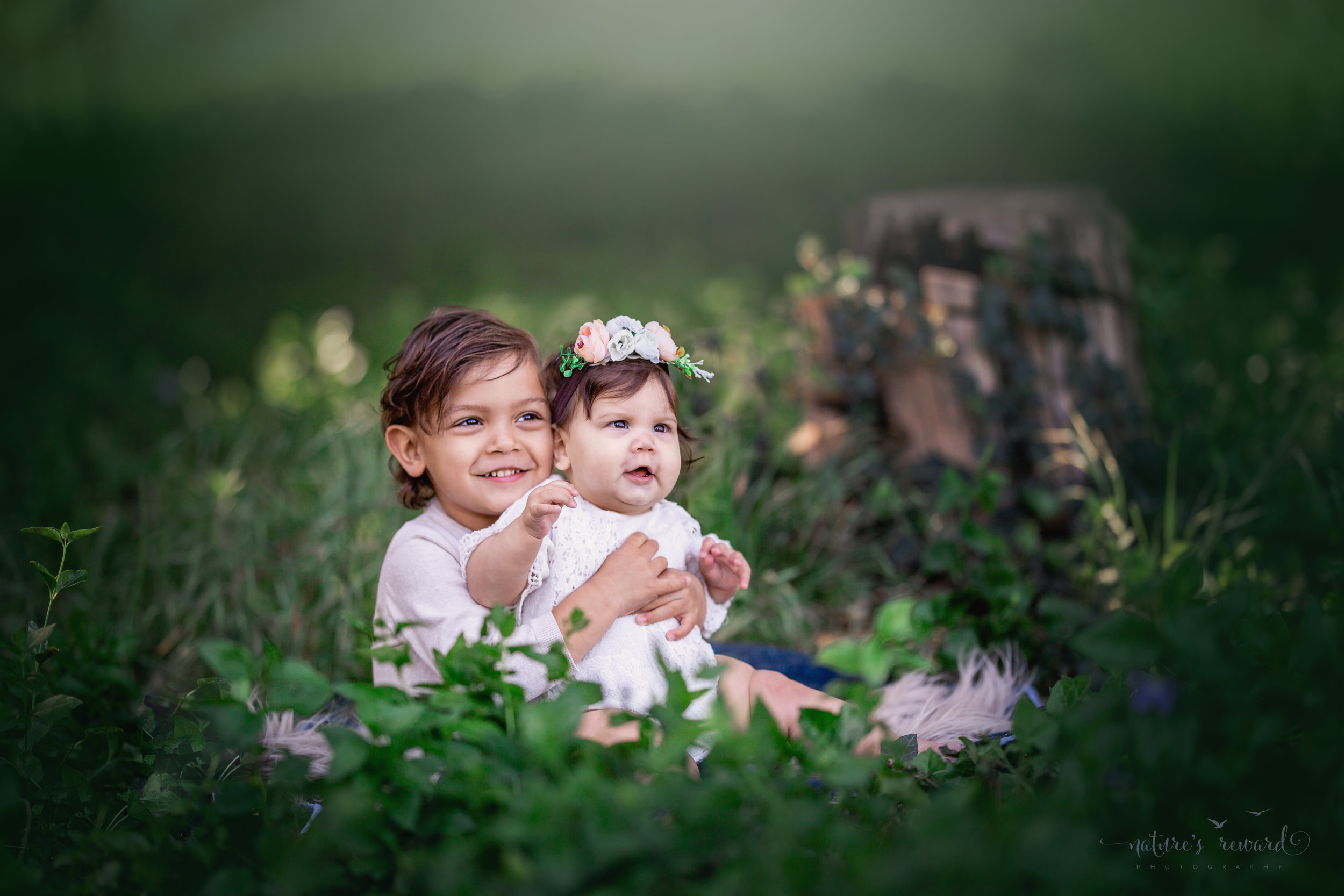 Big Brother holds his little sister in this sibling portrait by Nature's Reward Photography