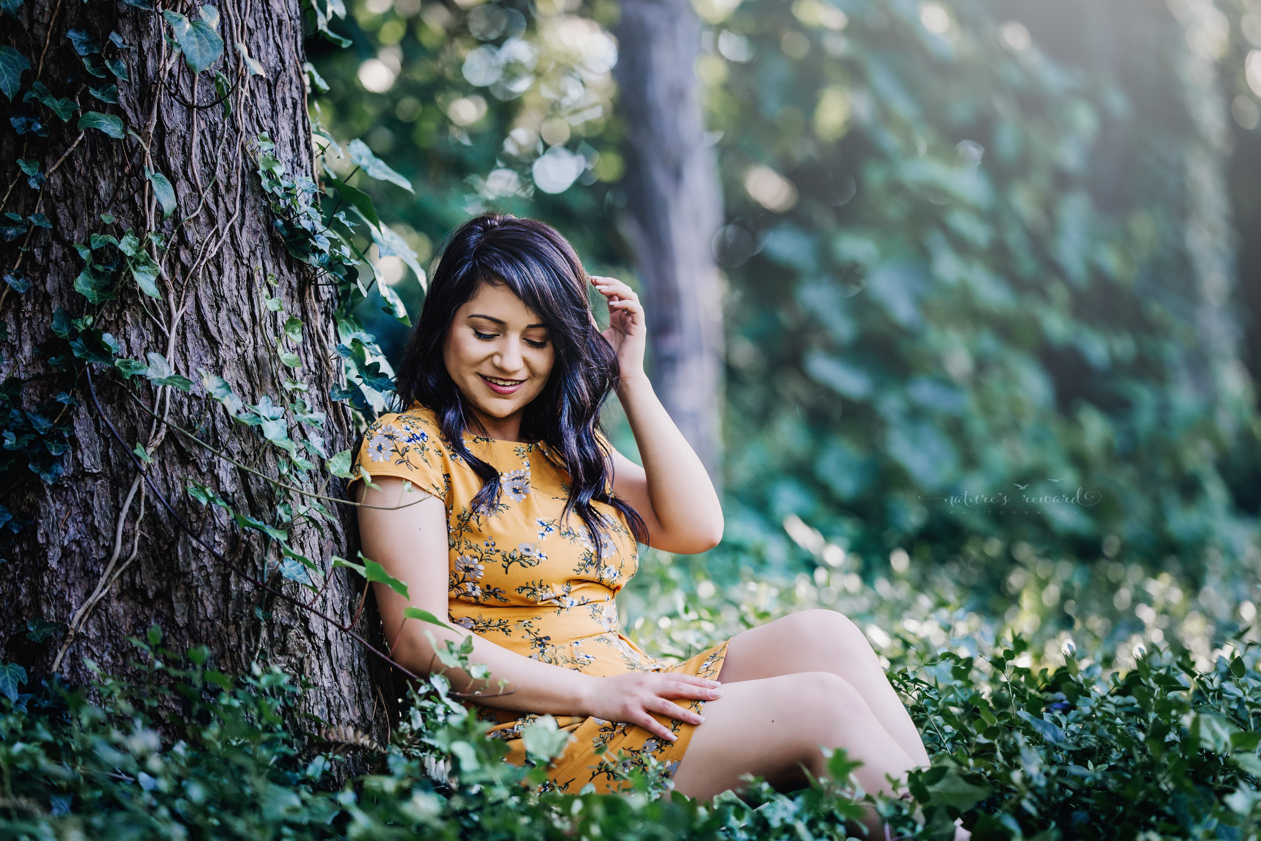 Class of 2018, California State University, San Bernardino Graduate wearing a yellow dress surrounded by the lush green of a park in Redlands, California in this Senior Portrait by Nature's Reward Photography.