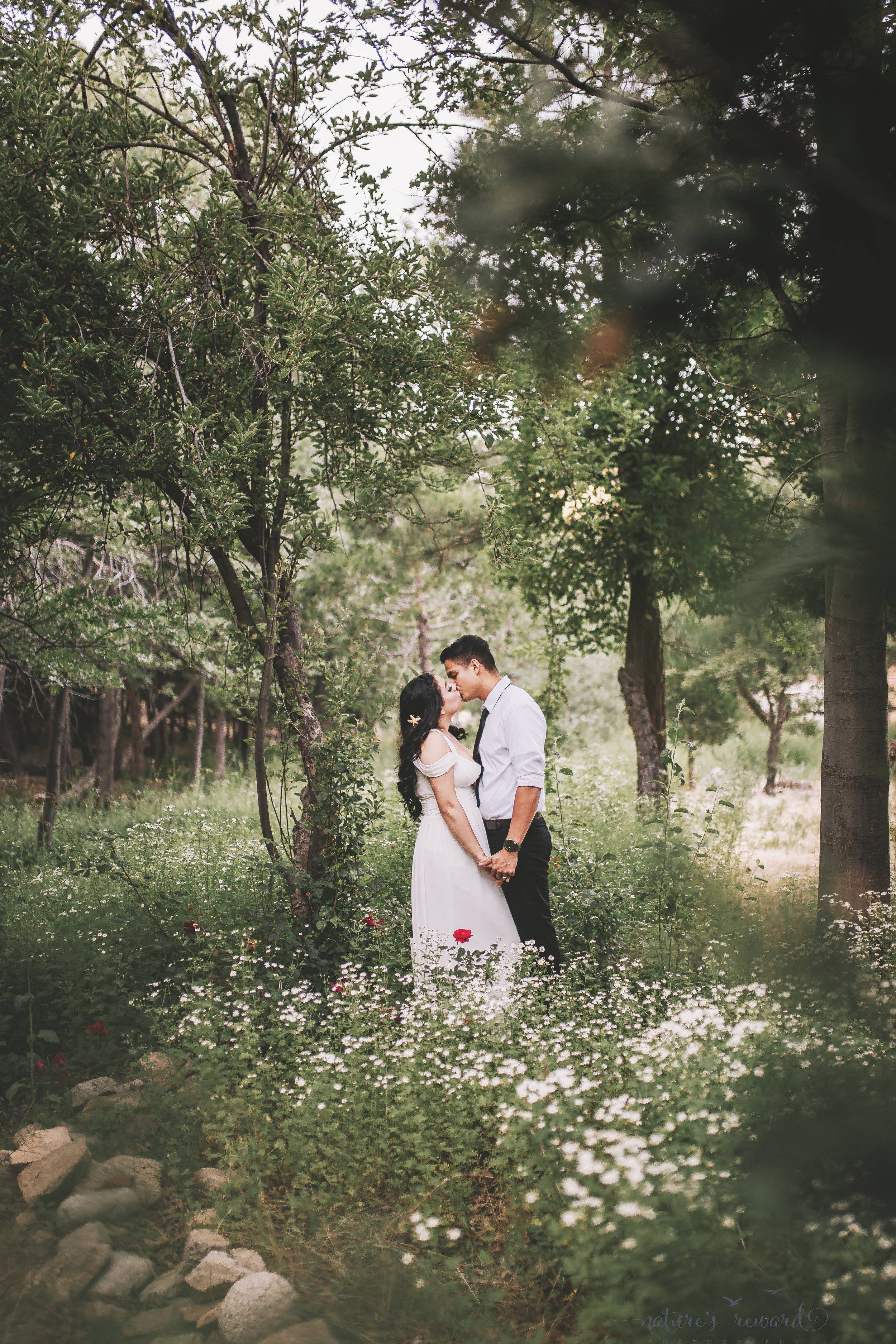 Once in a lifetime shot, invited into the personal propter by a bystander, this bride and groom kiss lovingly in this portrait by Nature's Reward Photography