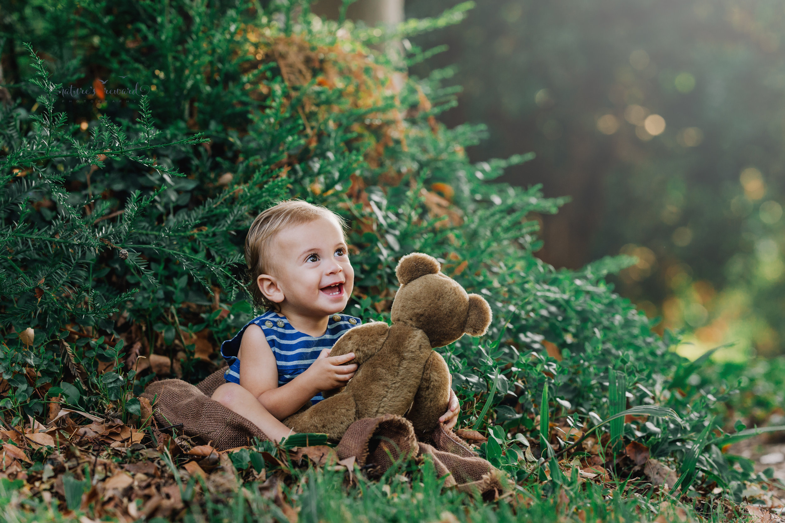 Gorgeous Baby boy holding his teddy smiling in this vintage inspired portrait by Nature's Reward Photography
