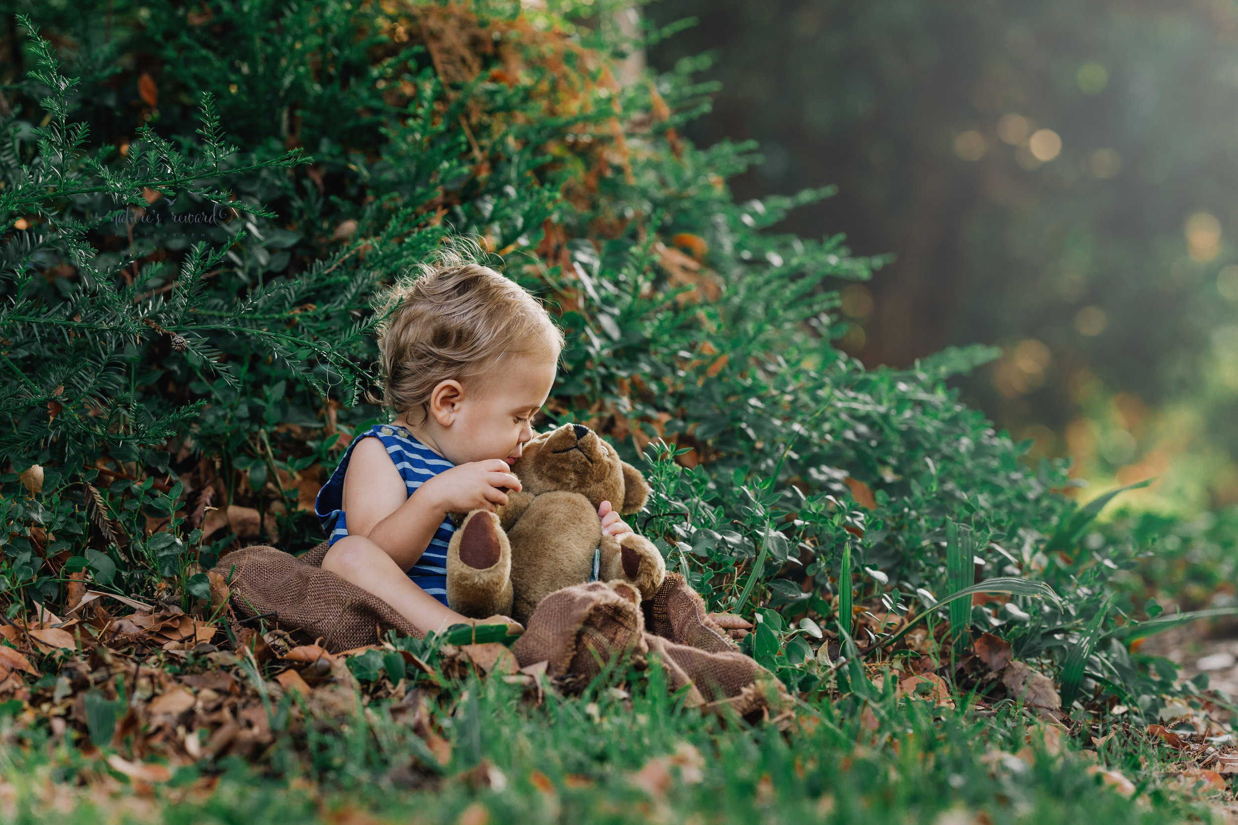 Gorgeous Baby boy kissing his teddy smiling in this vintage inspired portrait by Nature's Reward Photography