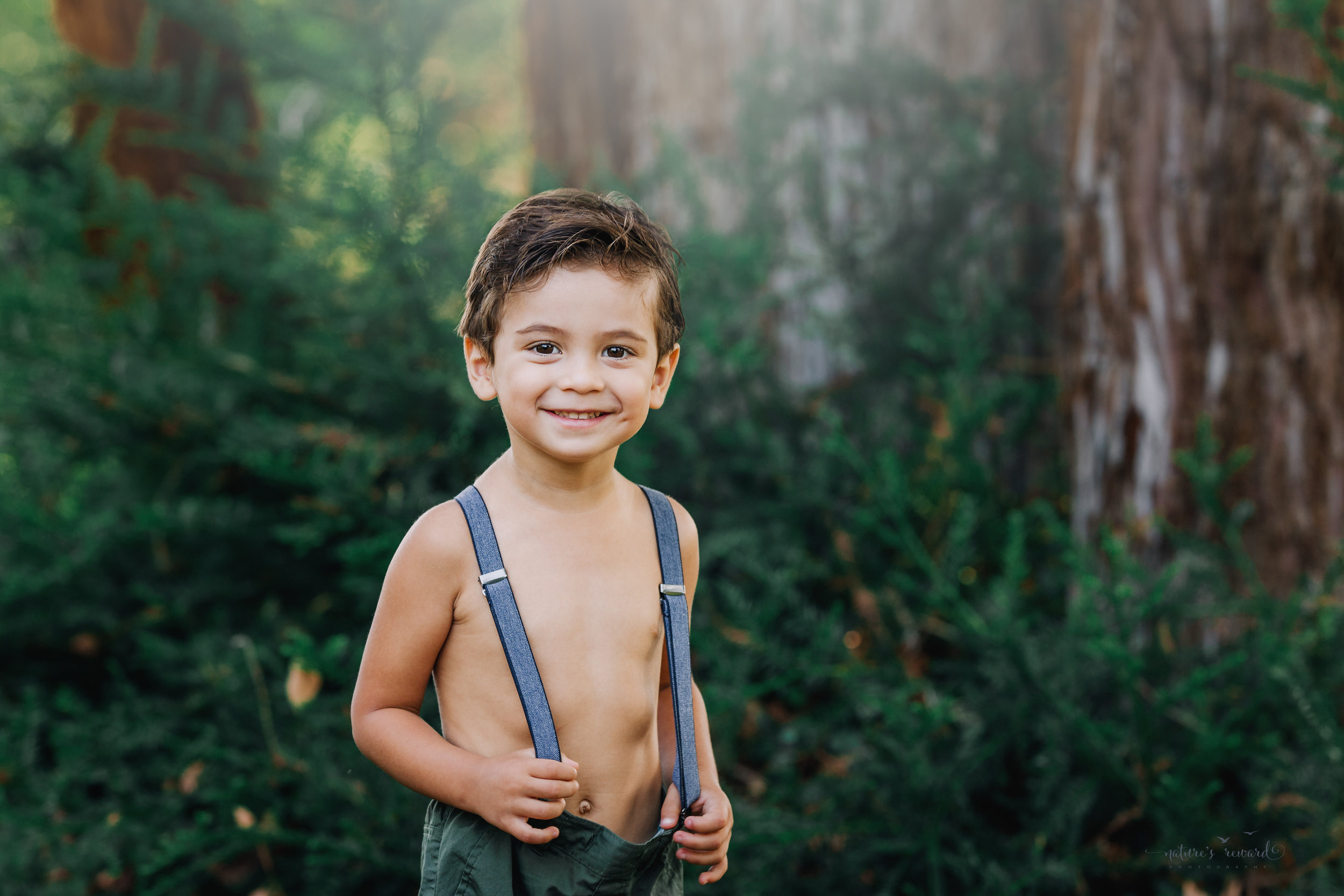 Beautiful toddler baby boy wearing the cutest pair of pants and suspenders in this vintage inspired portrait by Nature's Reward Photography