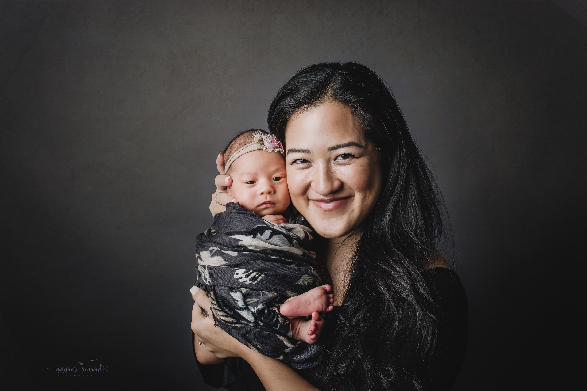 Perfect family newborn portrait by Nature's Reward Photography