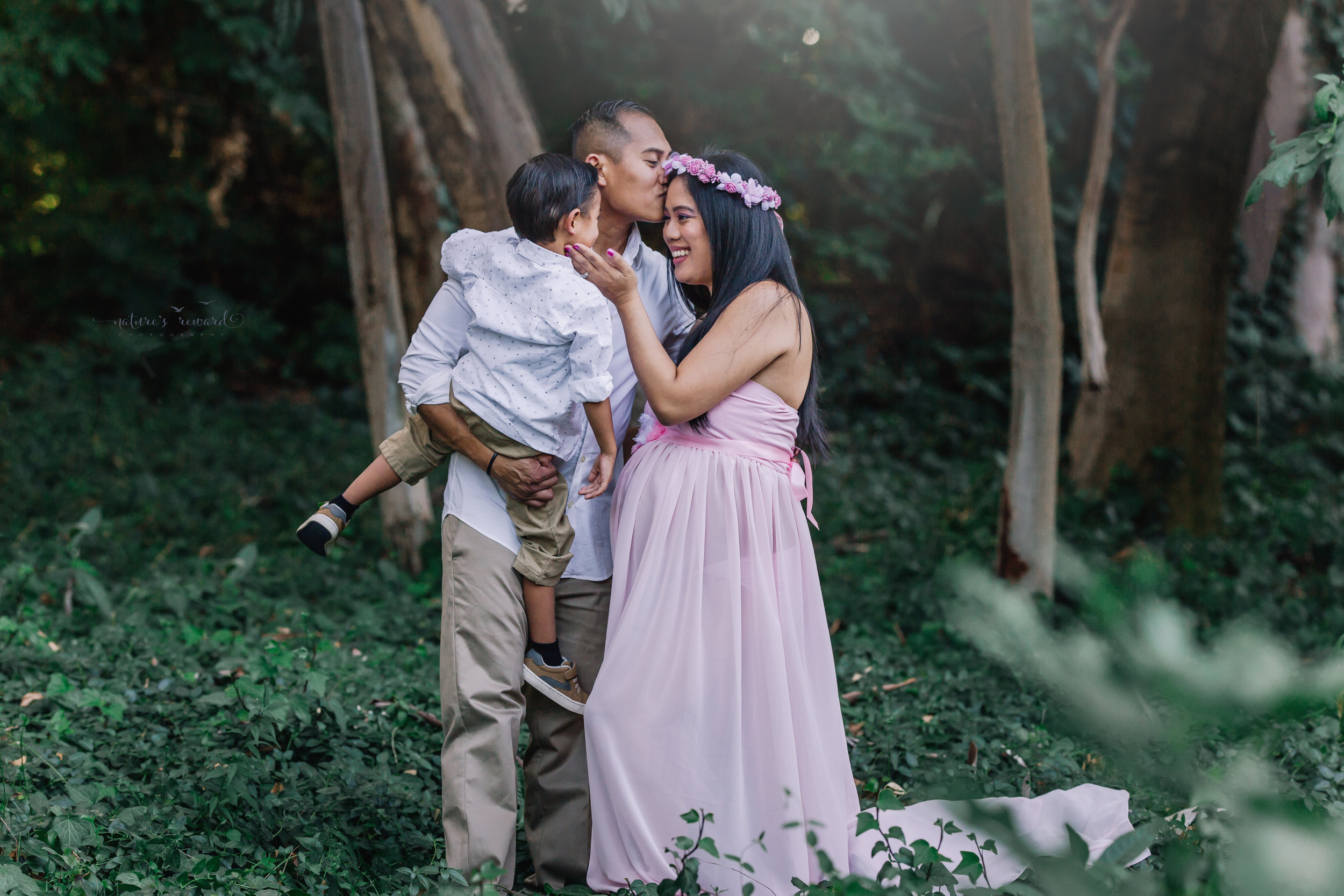 Loving moment in this family maternity portrait by Nature's Reward Photography