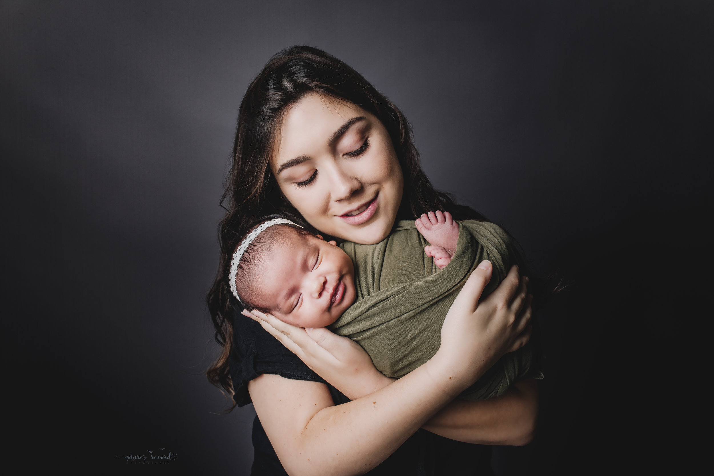 Mom and newborn baby girl portrait by Nature's Reward Photography