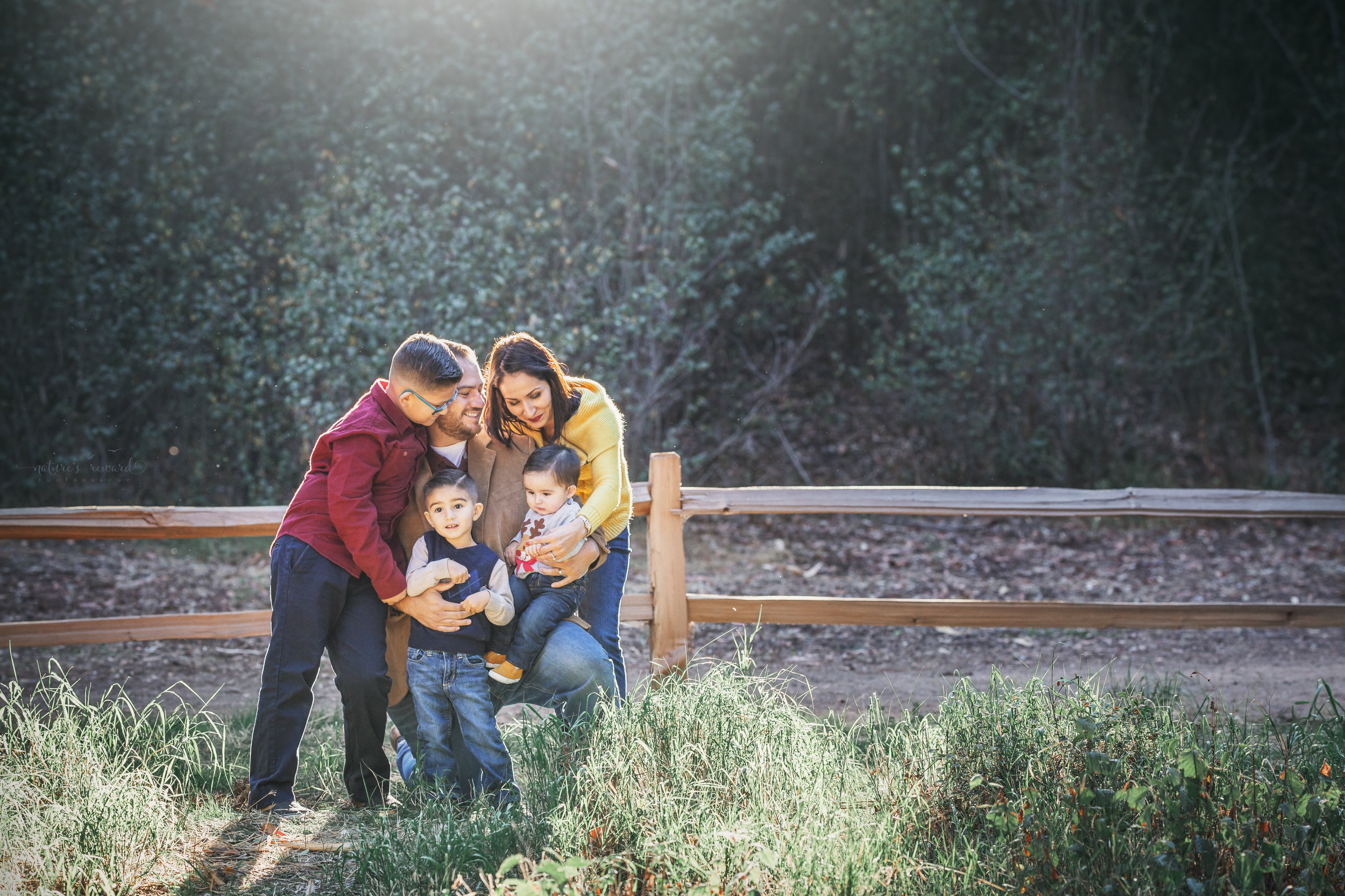 A candid of a family in a park setting by Nature's Reward Photography