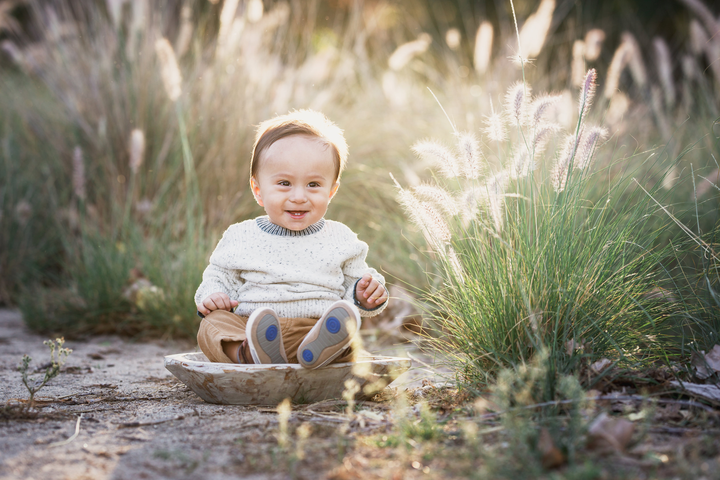 Beautiful baby boy by the long grass- a sitter portrait by Nature's Reward Photography