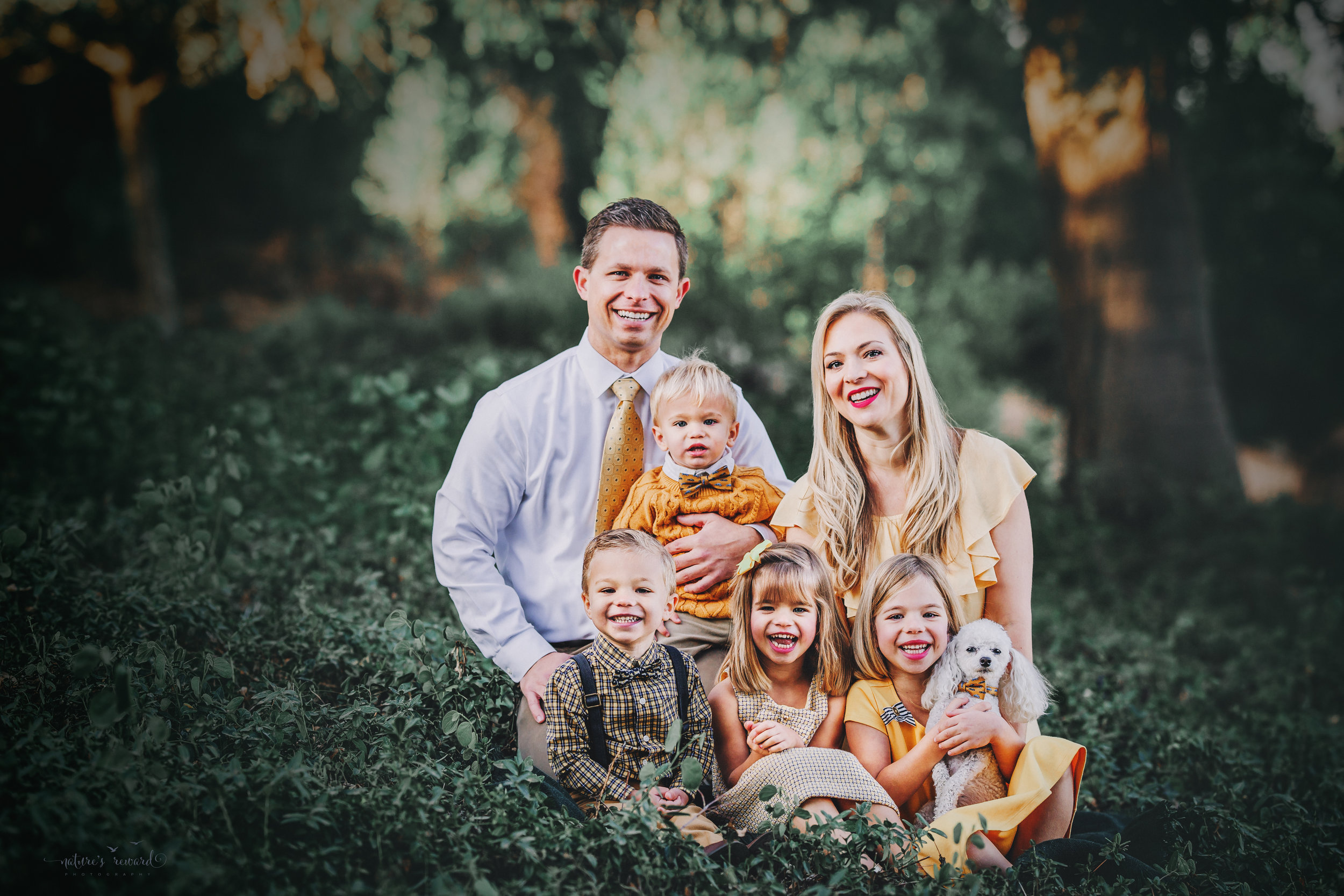 Gorgeous family wearing yellow and tan and whites with their fur baby 2 daughters and 2 sons- A portrait By Nature's Reward Photography!