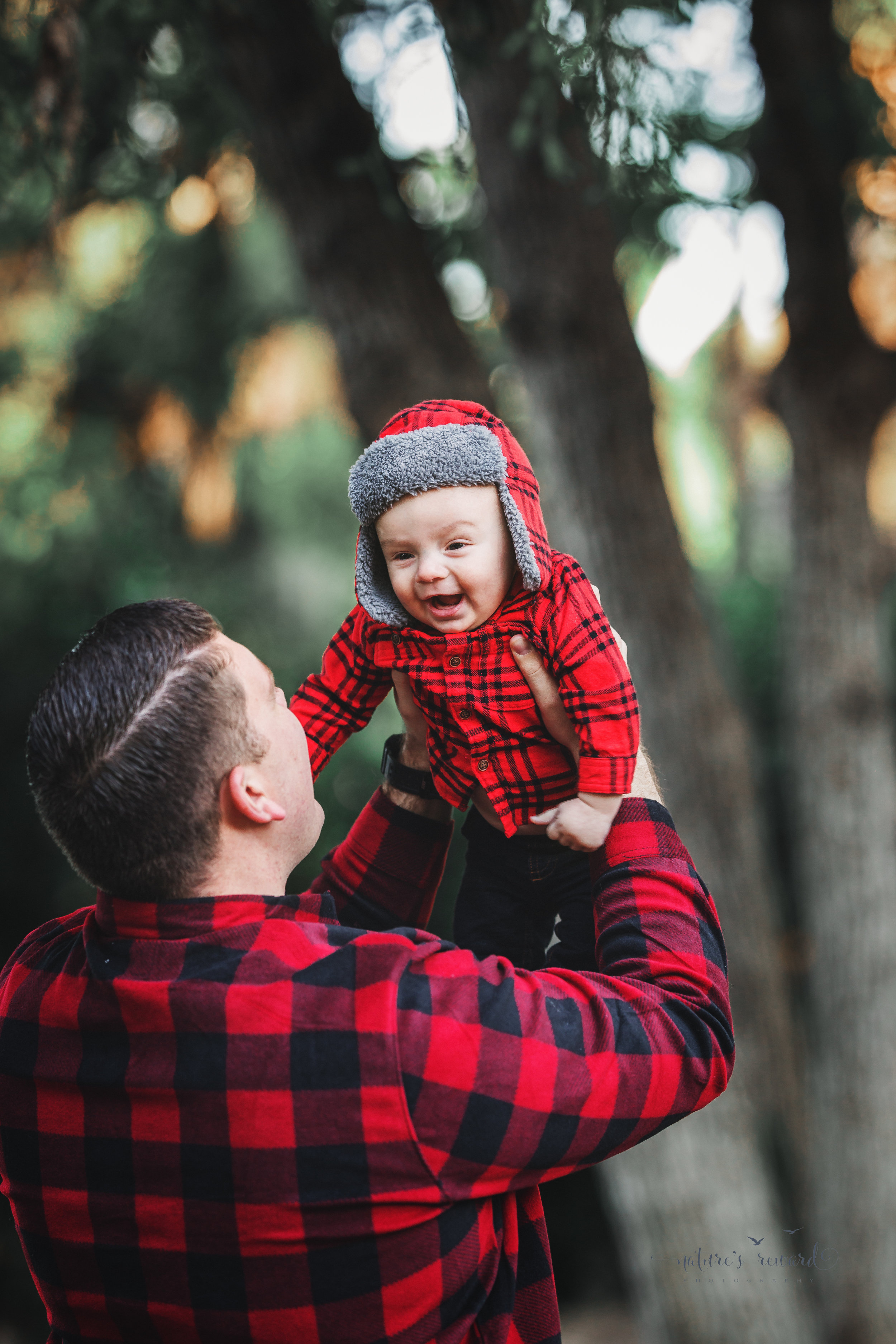 6 month old baby boy with his daddy in a lush green park setting in Redlands, Ca. by San Bernardino photographer- Nature's Reward Photography