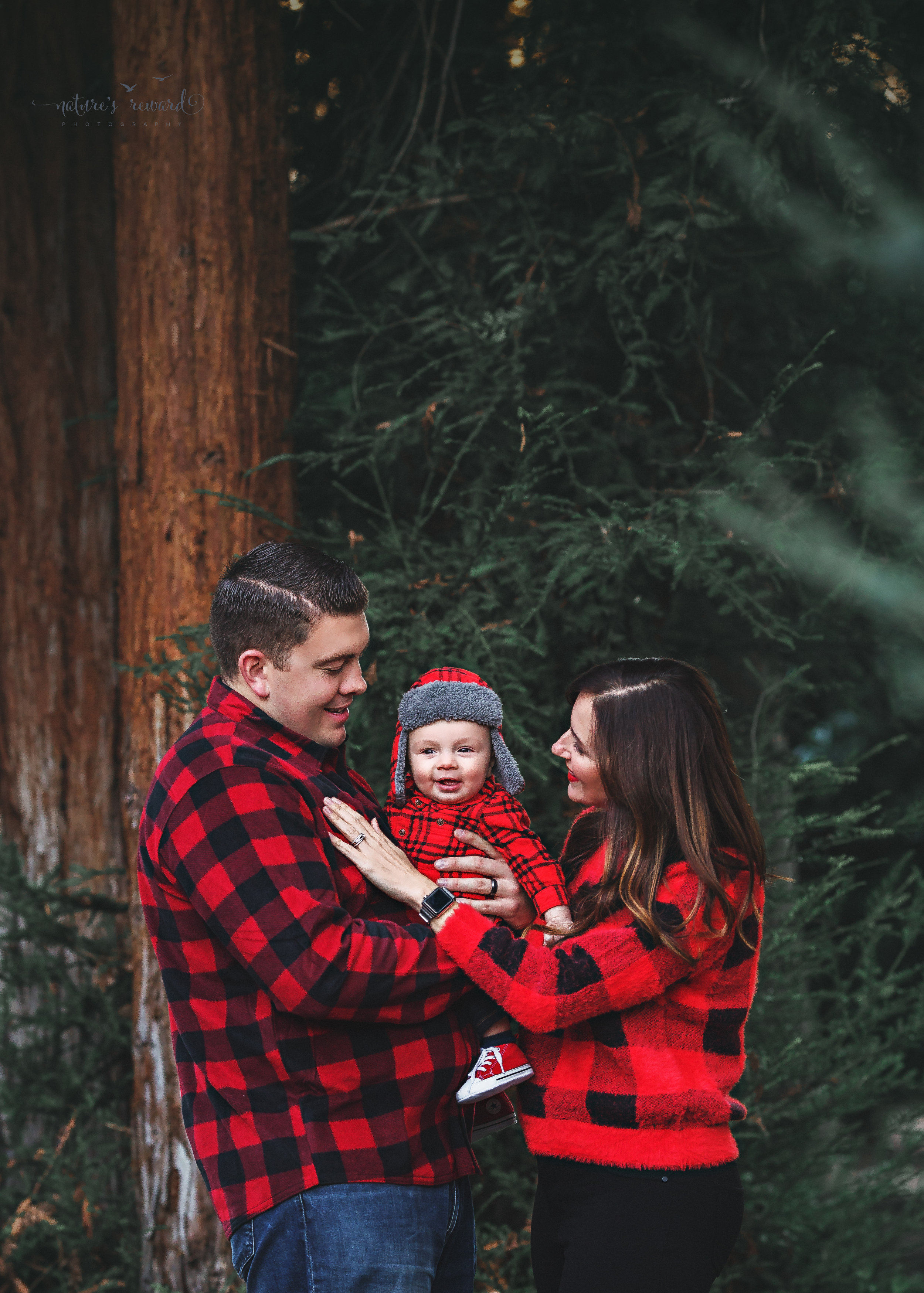 6 month old baby boy with his mommy and daddy in a lush green park setting in Redlands, Ca. by San Bernardino photographer- Nature's Reward Photography