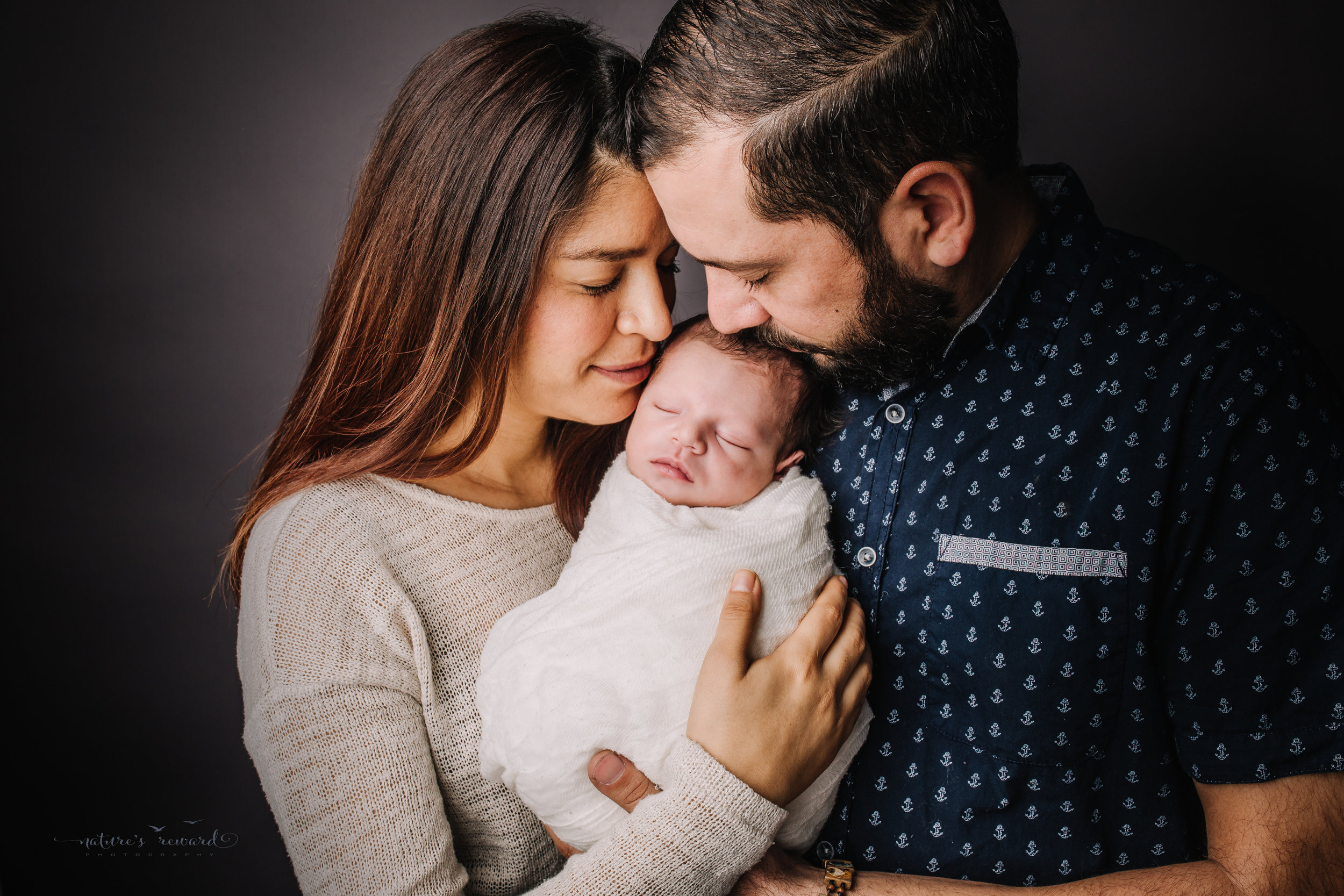 Newborn baby boy with his mom and dad by san Bernardino's maternity, newborn and family photography, Nature's Reward Photography
