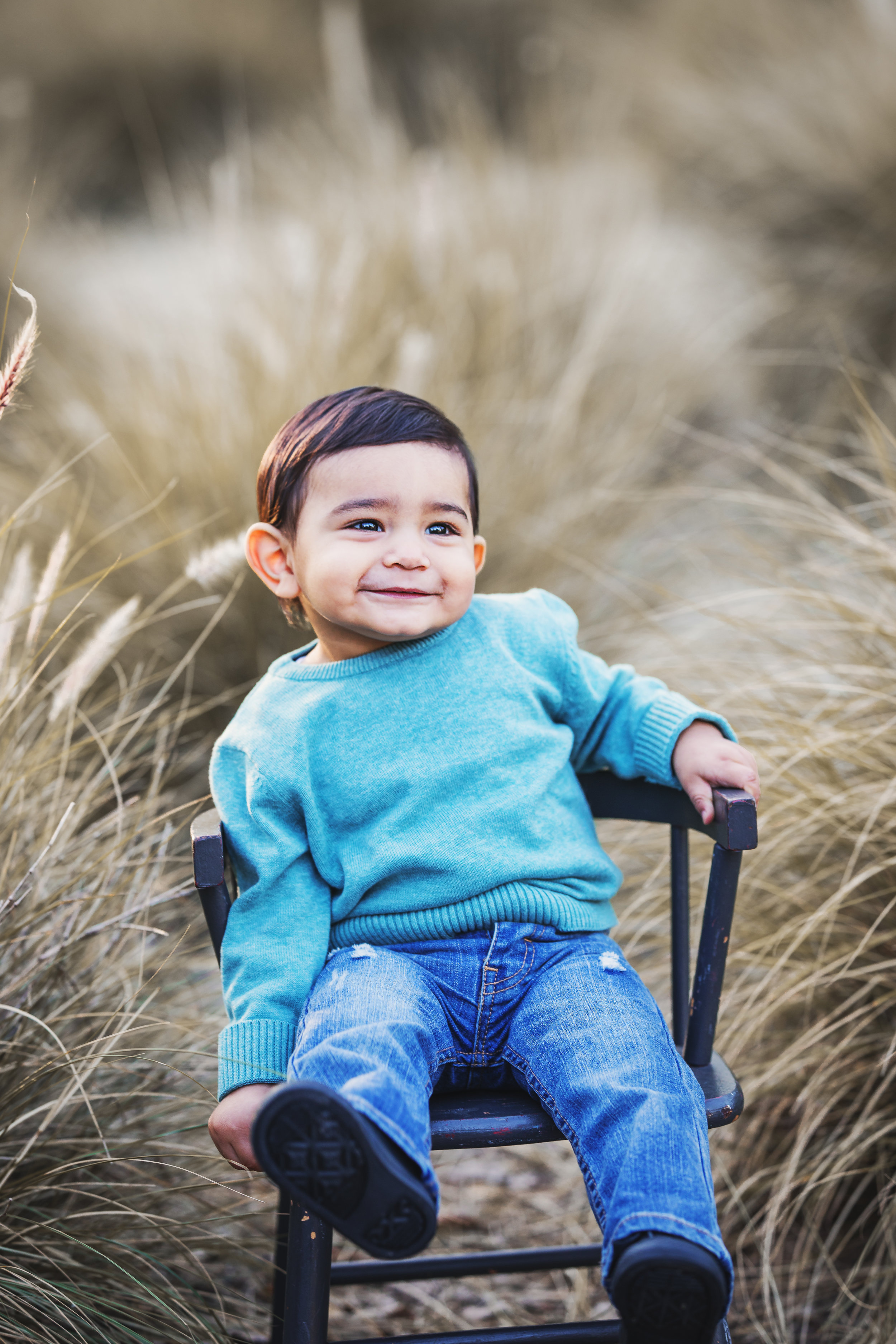 Beautiful baby boy in an aqua marine sweater in this portrait by Nature's Reward Photography