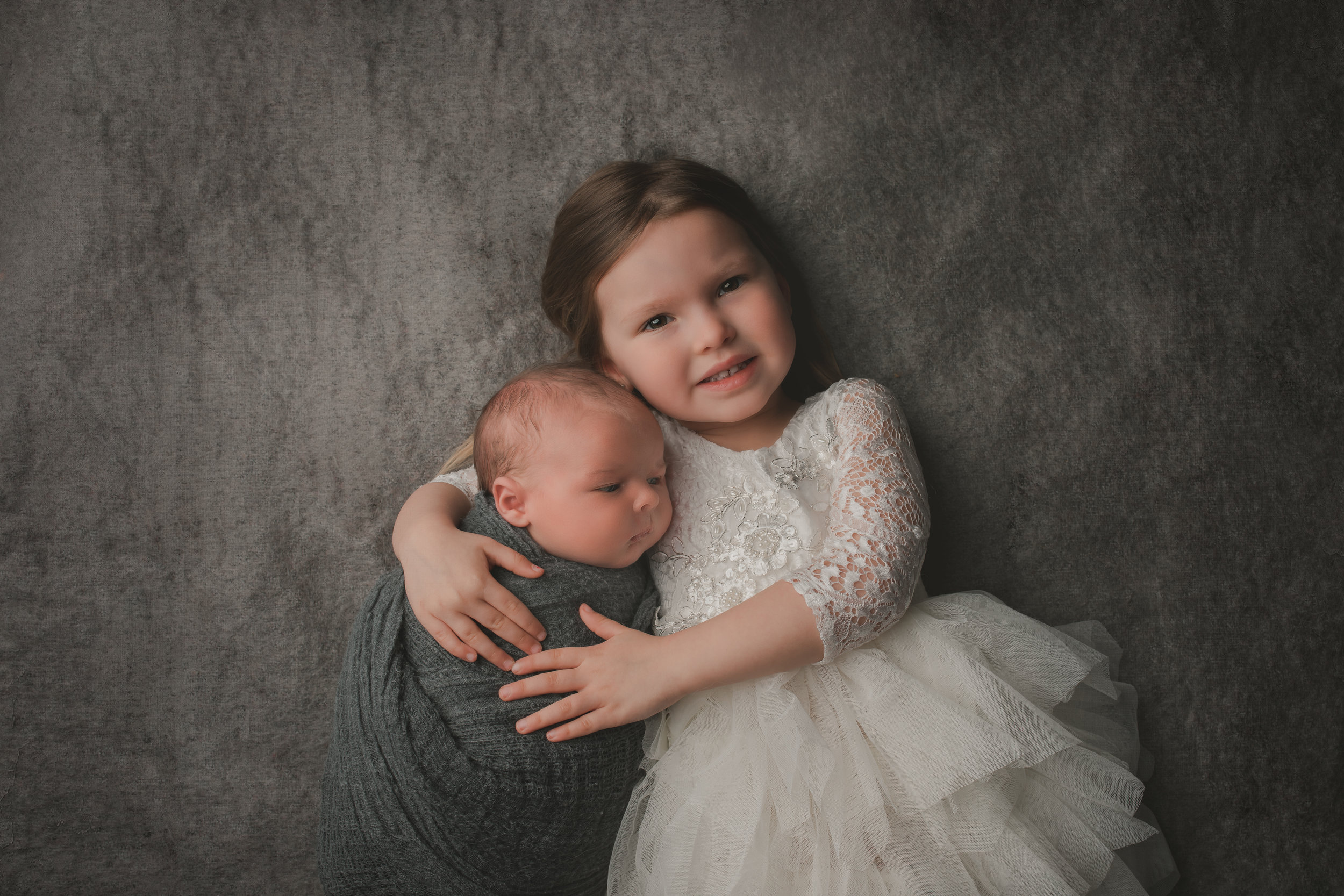 Newborn Baby boy and his big sister, a portrait by Nature's Reward Photography