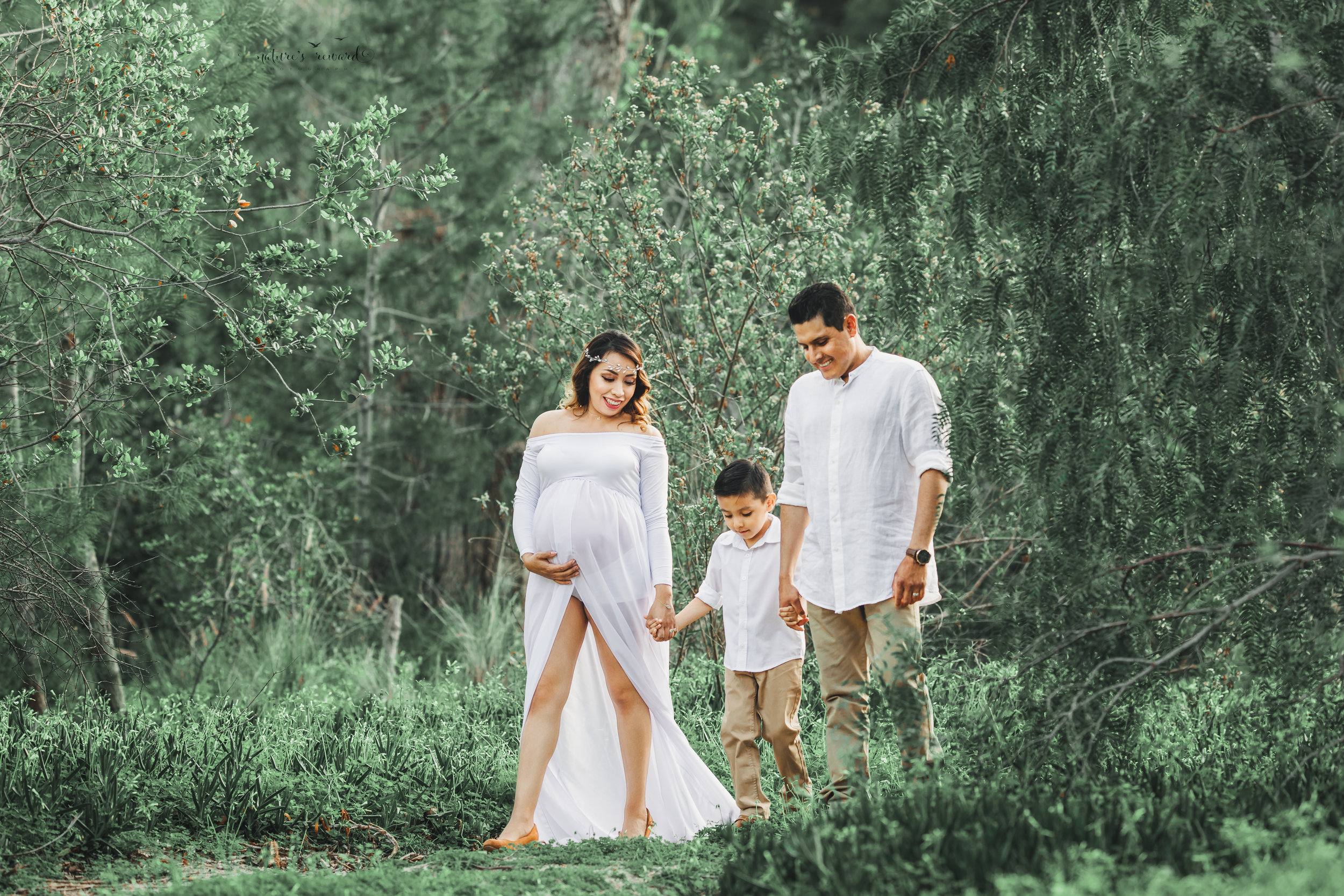 Expecting mother to be in white open front gown in this family maternity session portrait by Nature's Reward Photography