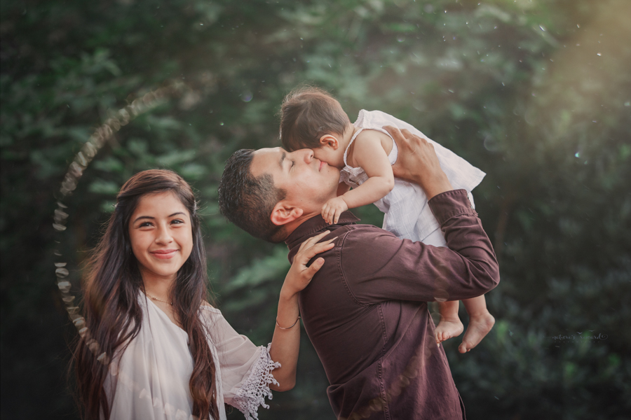 Dad and daughters portrait taken during a family session by Nature's Reward Photography