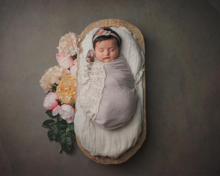 Newborn baby girl portrait by Nature's Reward Photography