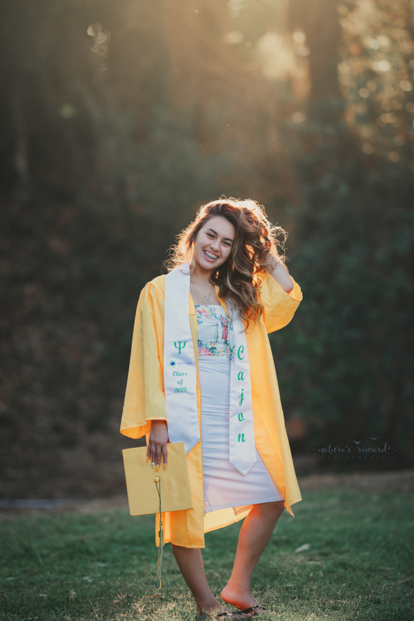 Gorgeous Young lady in her cap and gown during her senior session, a portrait by Nature's Reward Photography