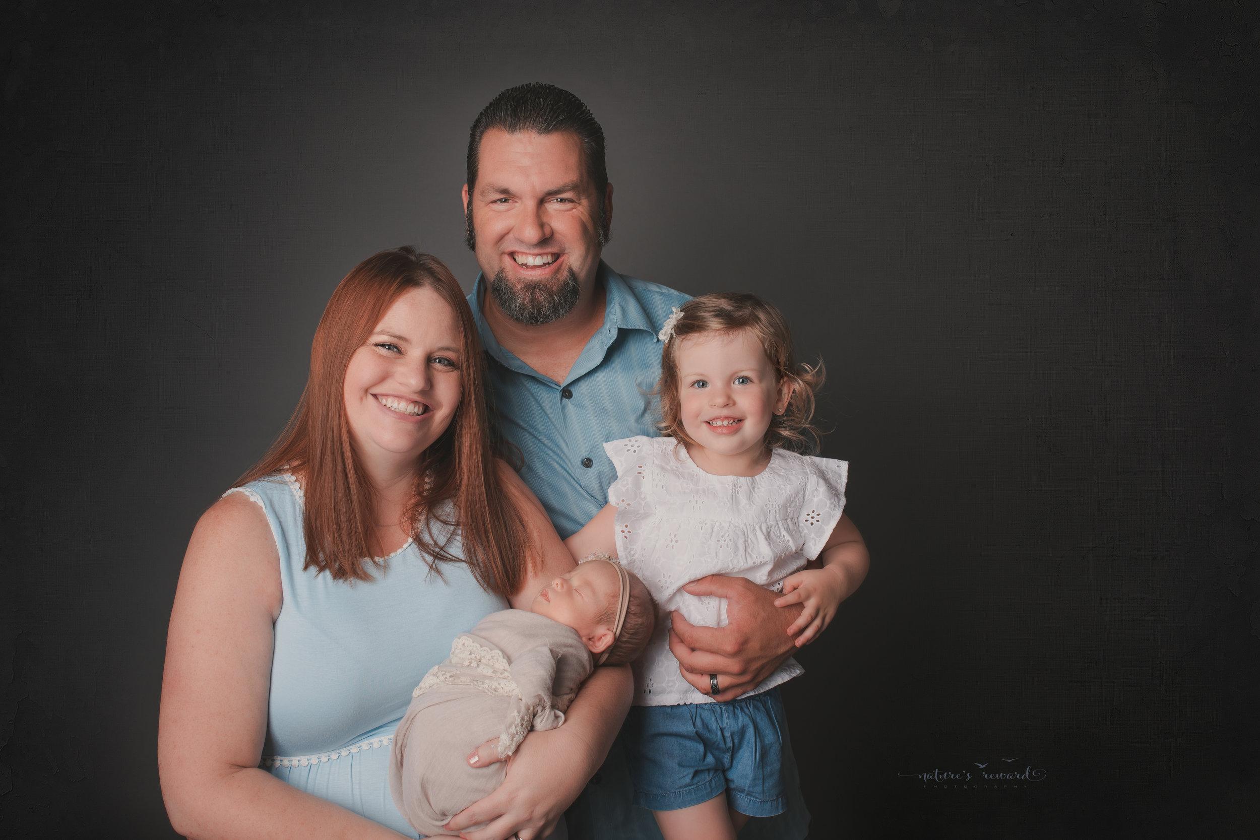 A happy family portrait, a newborn portrait by Nature's Reward Photography